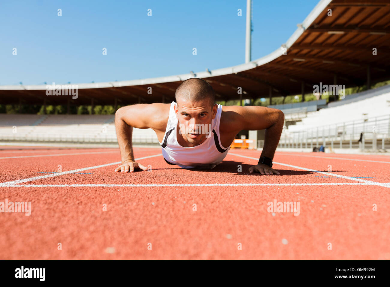 Young sportsman doing pushups - Stock Image