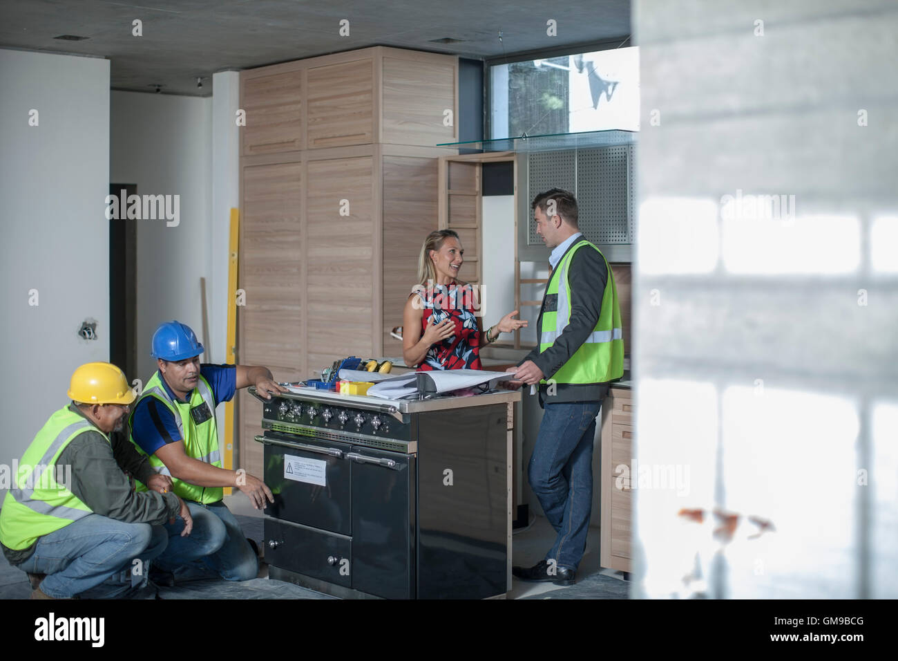 Architect and woman discussing kitchen furnishing Stock Photo