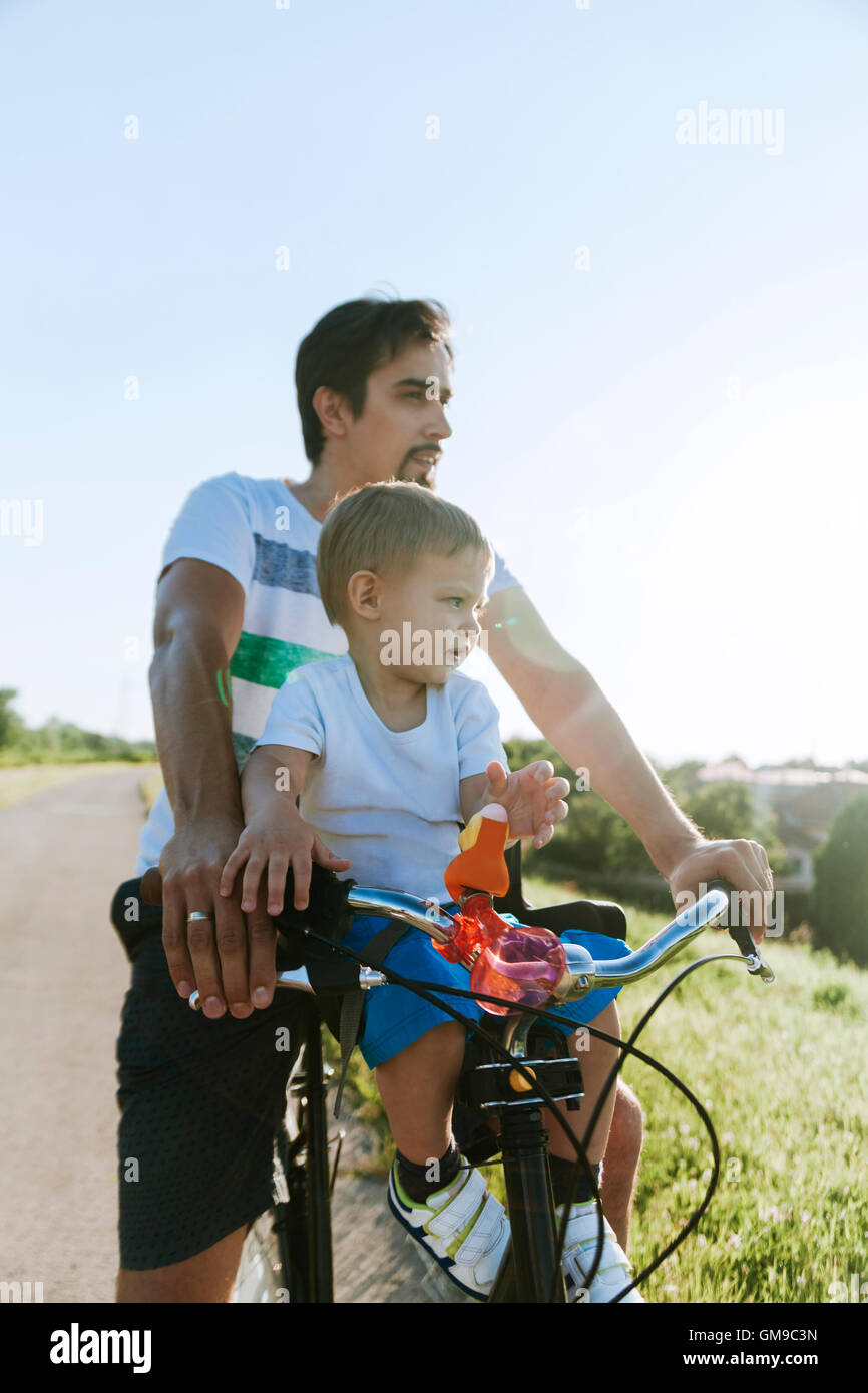 Little boy on bicycle tour with his father Stock Photo