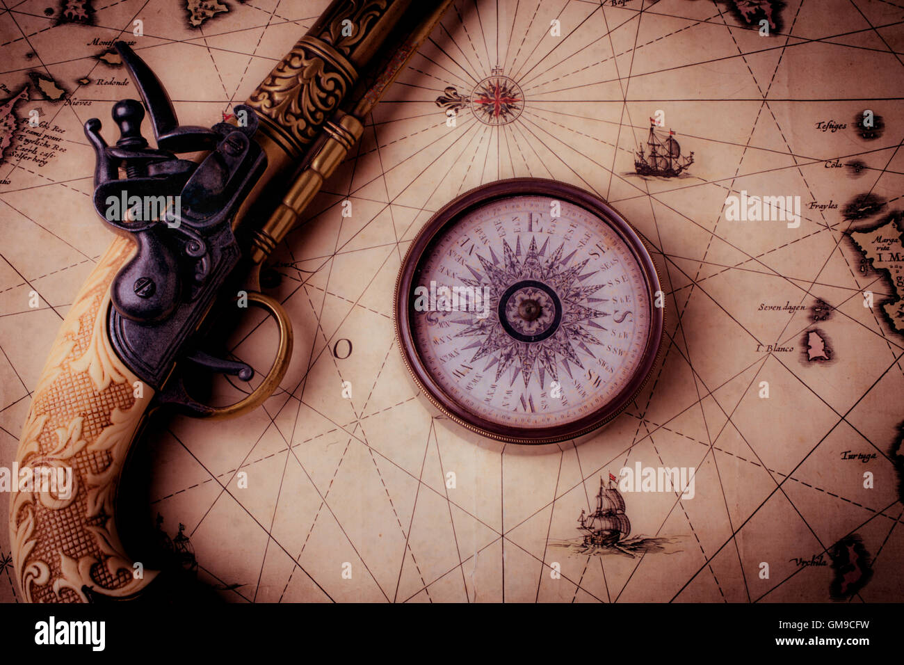 Compass And Pistole On Old Map - Stock Image