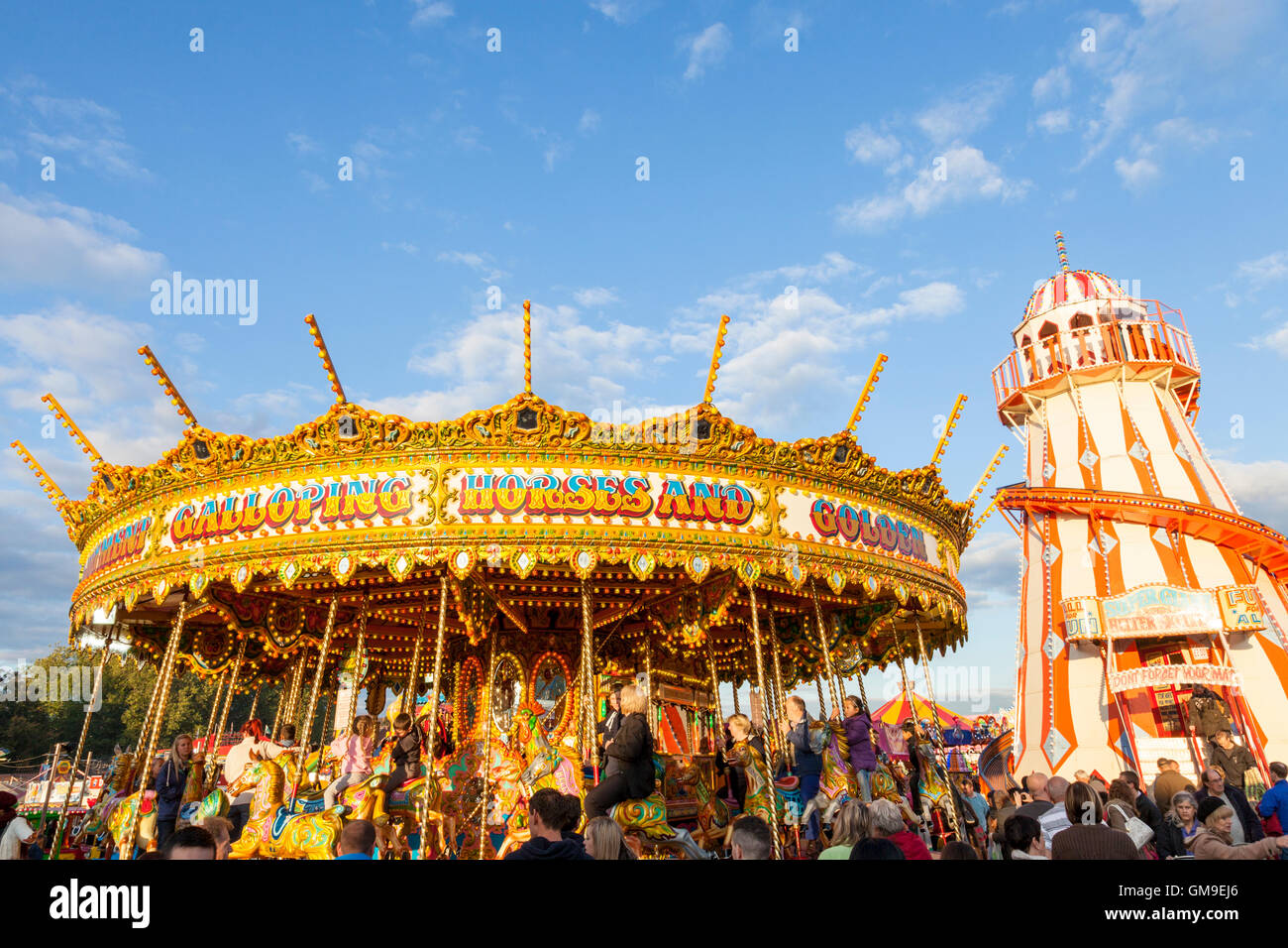 Traditional funfair rides. A merry go round and helter skelter at Goose Fair, Nottingham, England, UK Stock Photo