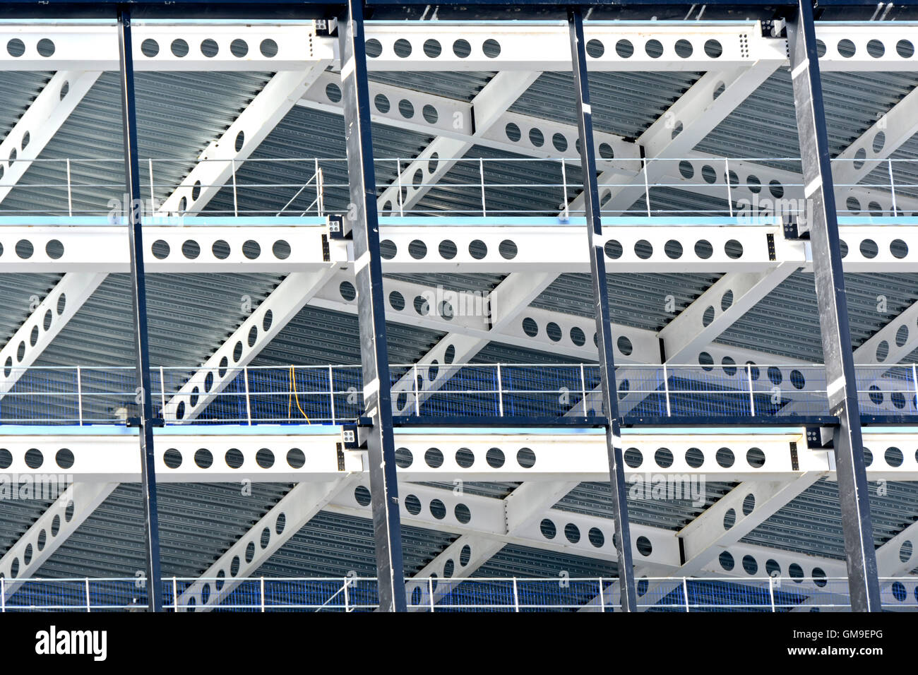 Steel frame office building under consruction beside East Croydon UK train station seen as a pattern & shapes image circles squares & rectangles etc Stock Photo