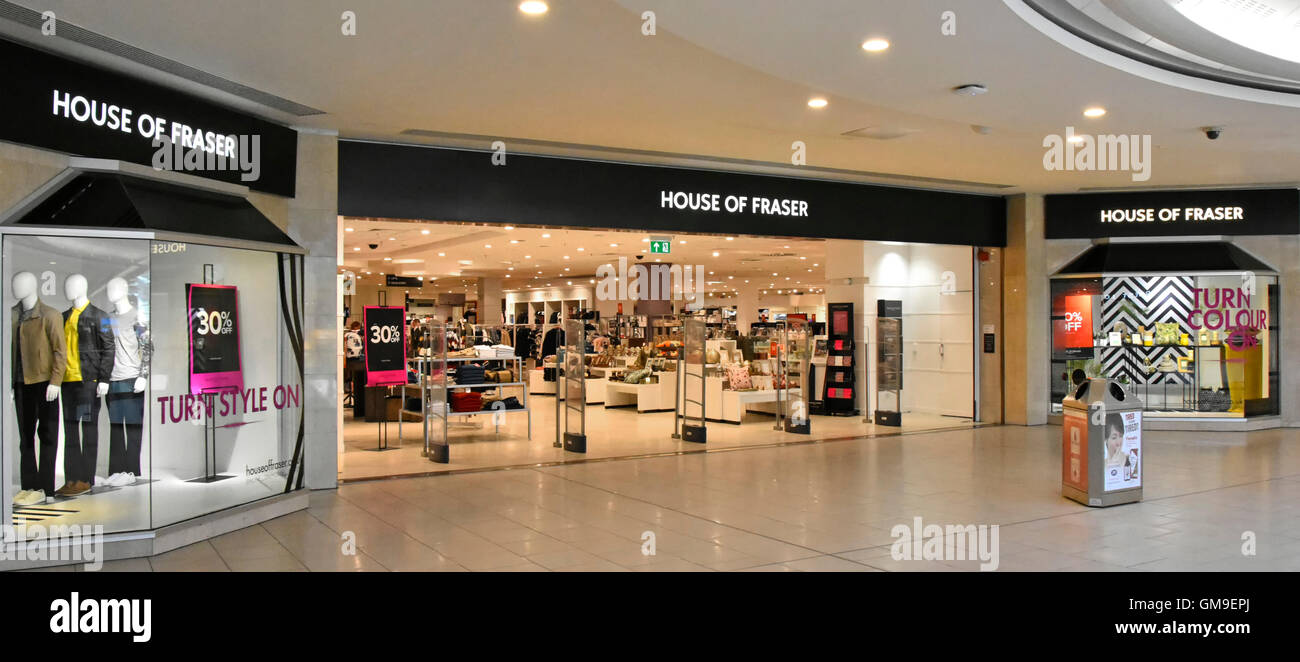 Shopping mall entrance to House of Fraser department store retail business shop front window display Intu Lakeside - Stock Image