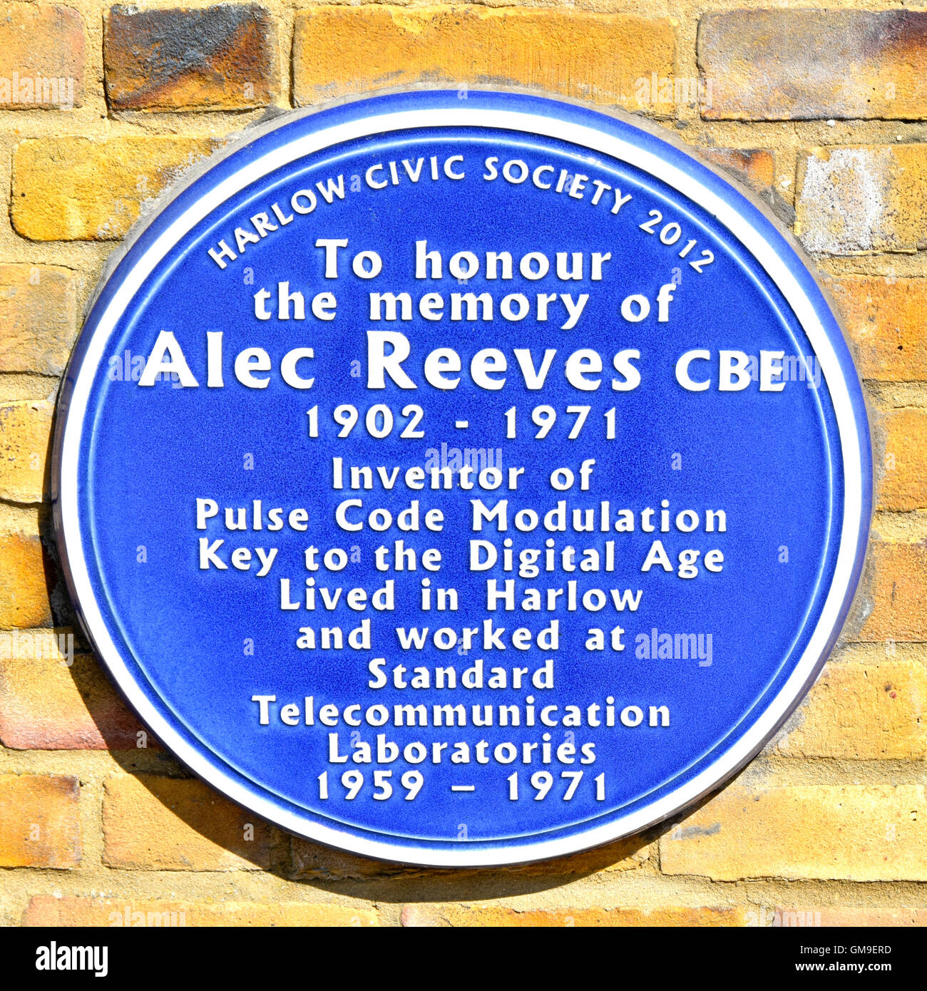 Blue Plaque on Harlow Essex England UK Civic Centre town hall wall to honour the memory of Alec Reeves CBE who invented - Stock Image
