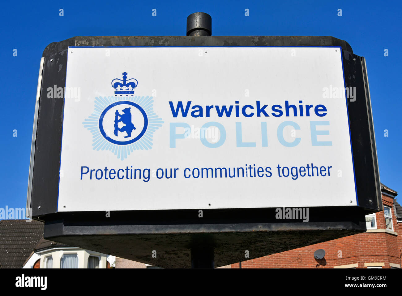 British Warwickshire Police force sign outside Rugby Police station slogan protecting our communities together in - Stock Image