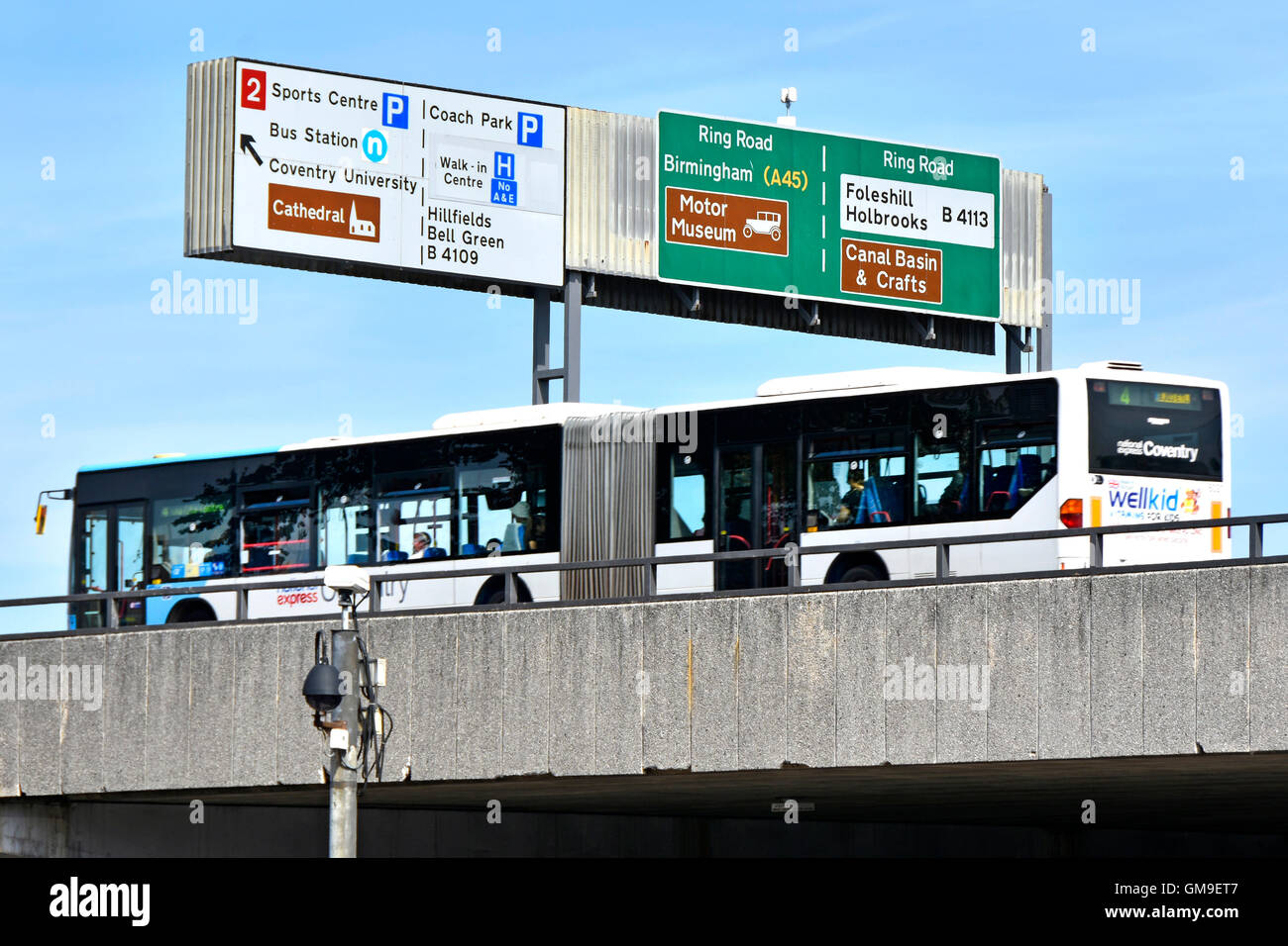 Bendy bus local route operated by National Express on elevated Coventry ring road West Midlands England UK passing - Stock Image