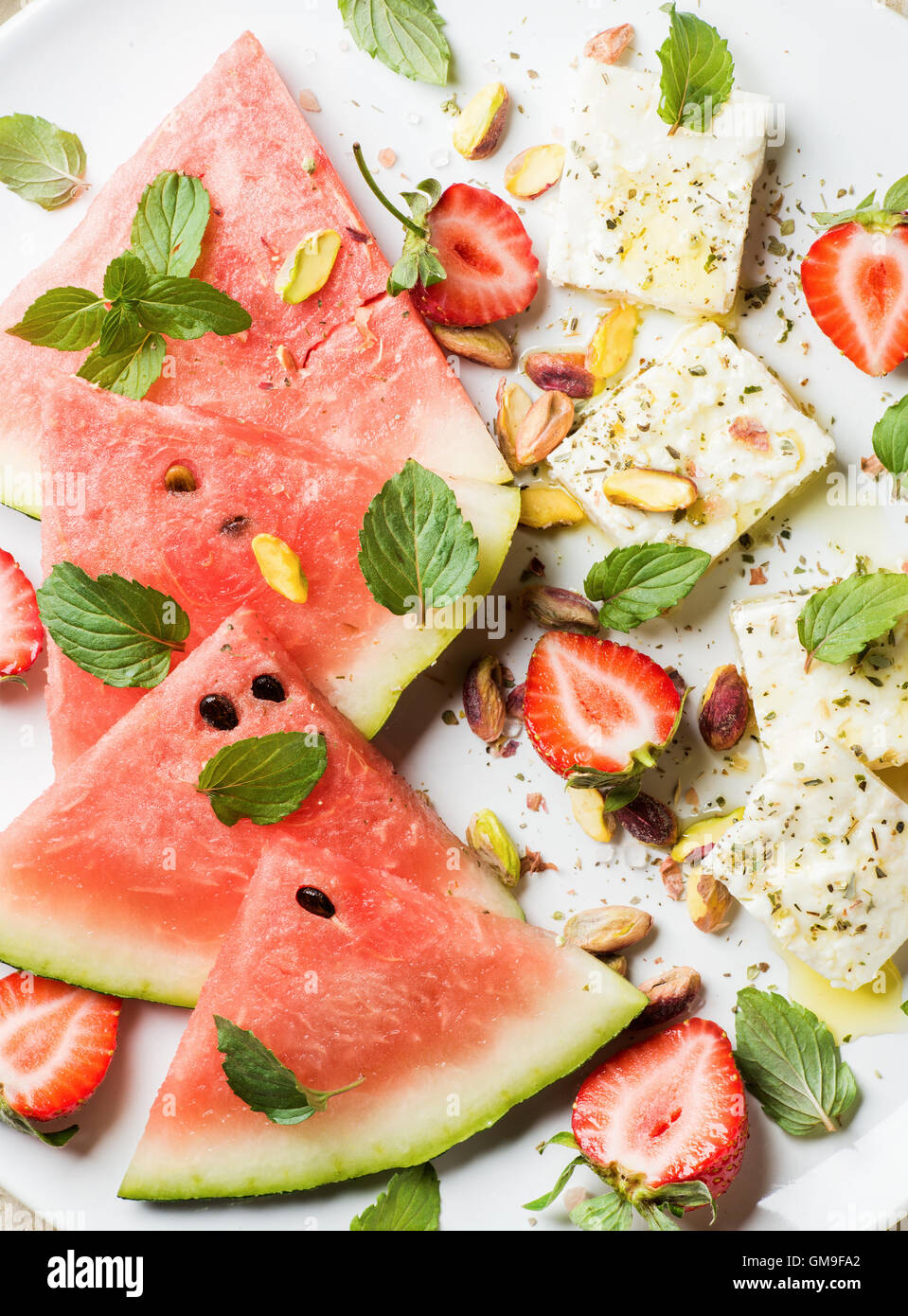 Summer watermelon, strawberry and feta cheese salad with pistachios - Stock Image
