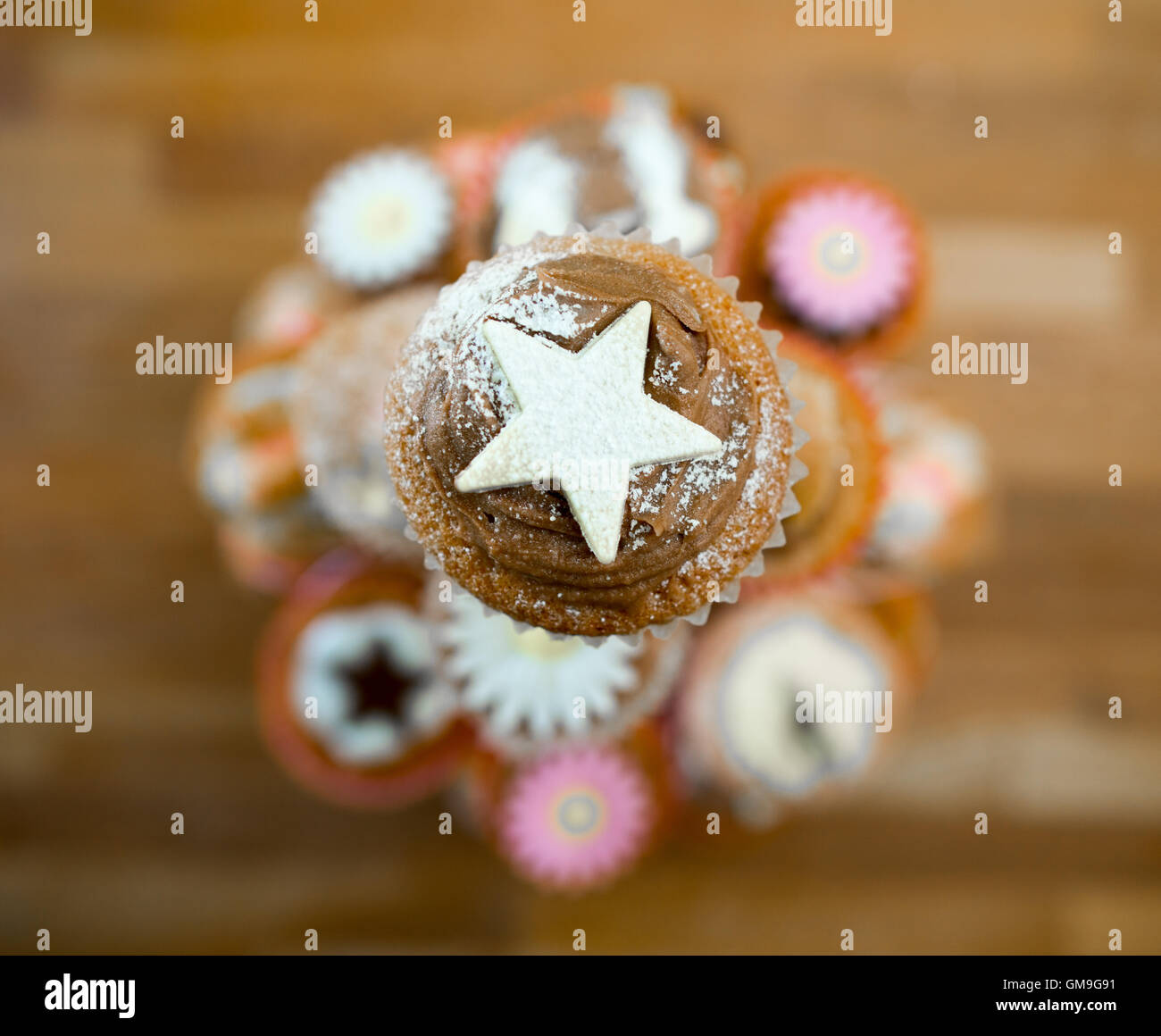 Decorated cupcakes on a display stand. - Stock Image