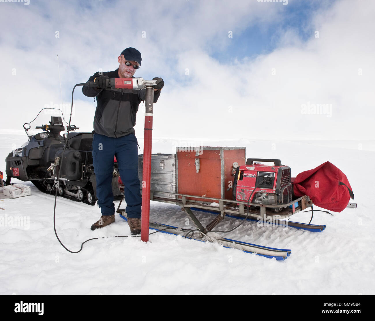 Scientist with ice core samples doing glacial research on Vatnajokull Ice Cap, Iceland - Stock Image