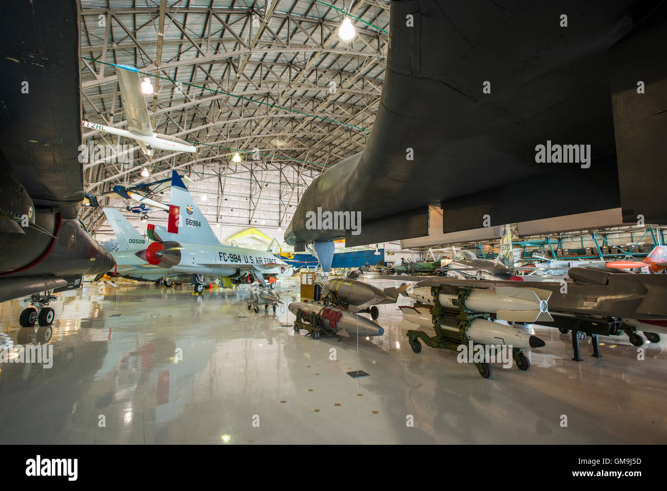 Bombs under the wings of a B-1A Lancer, Wings over the Rockies Air and Space Museum, Denver, Colorado. - Stock Image