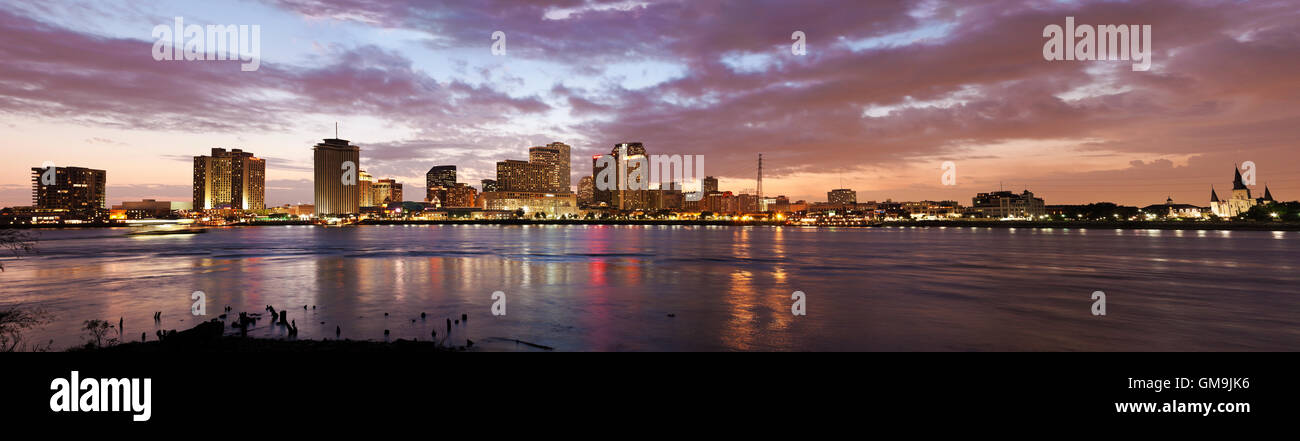 Louisiana, New Orleans, Mississippi river and city skyline with skyscrapers at sunset - Stock Image