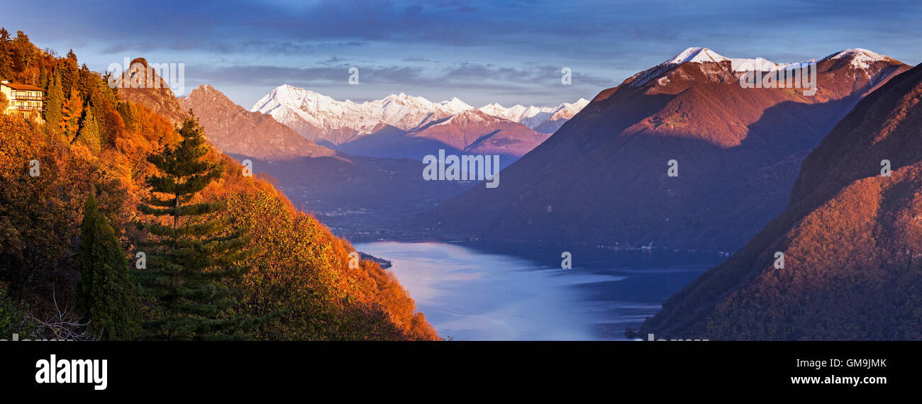 Switzerland, Lugano, Horizontal panorama of mountains and lake at sunset - Stock Image