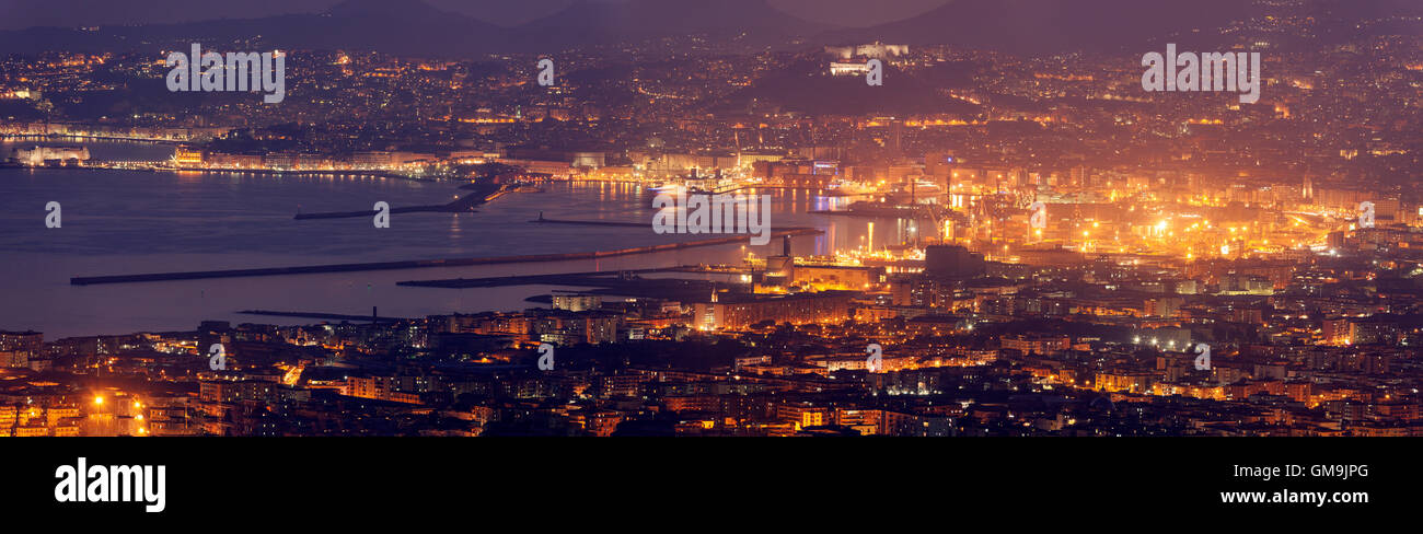 Italy, Campania, Naples, Panorama of city at night - Stock Image