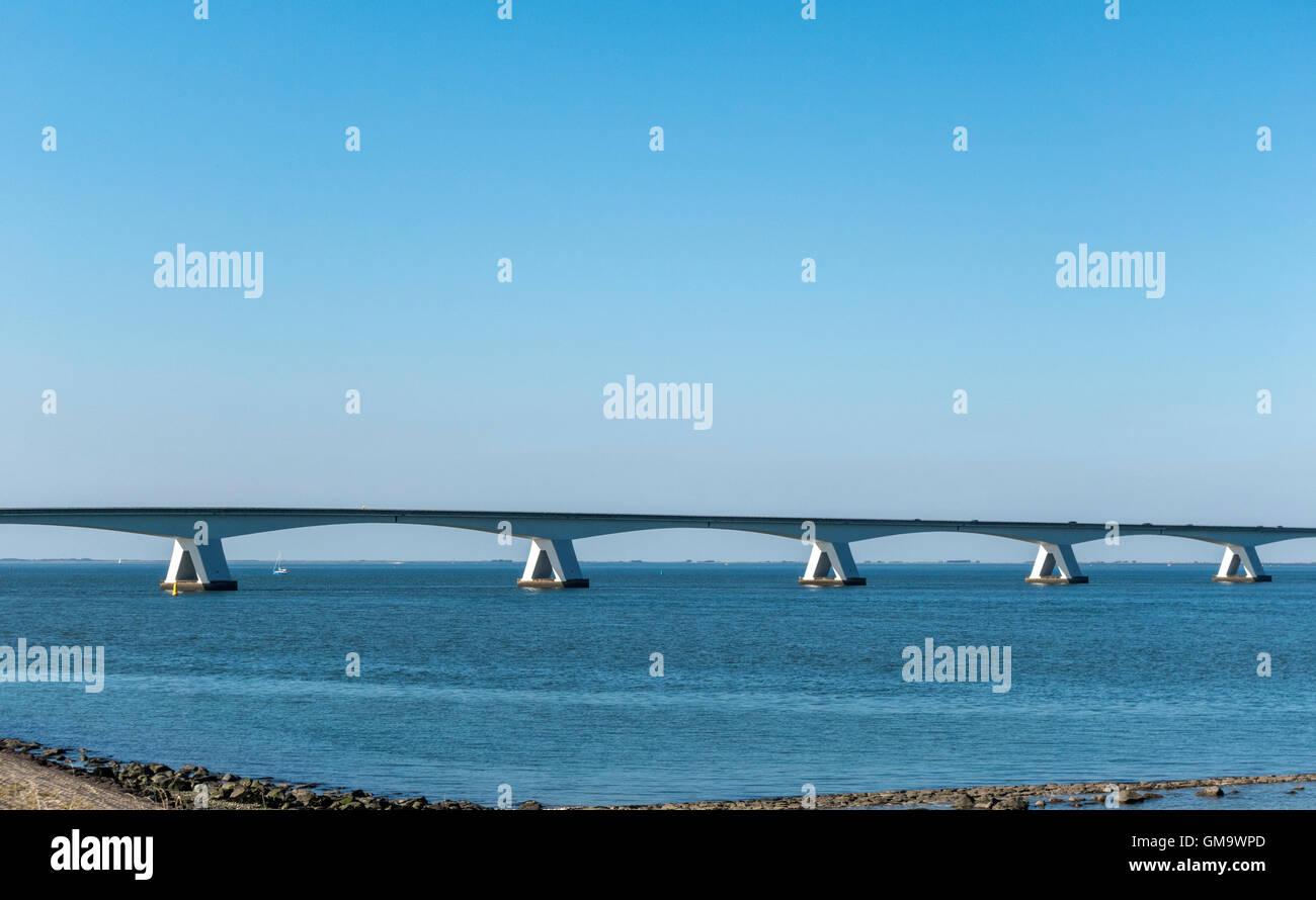 The Zeeland Bridge (Dutch: Zeelandbrug) is the longest bridge in the Netherlands. It spans the Oosterschelde estuary. Stock Photo