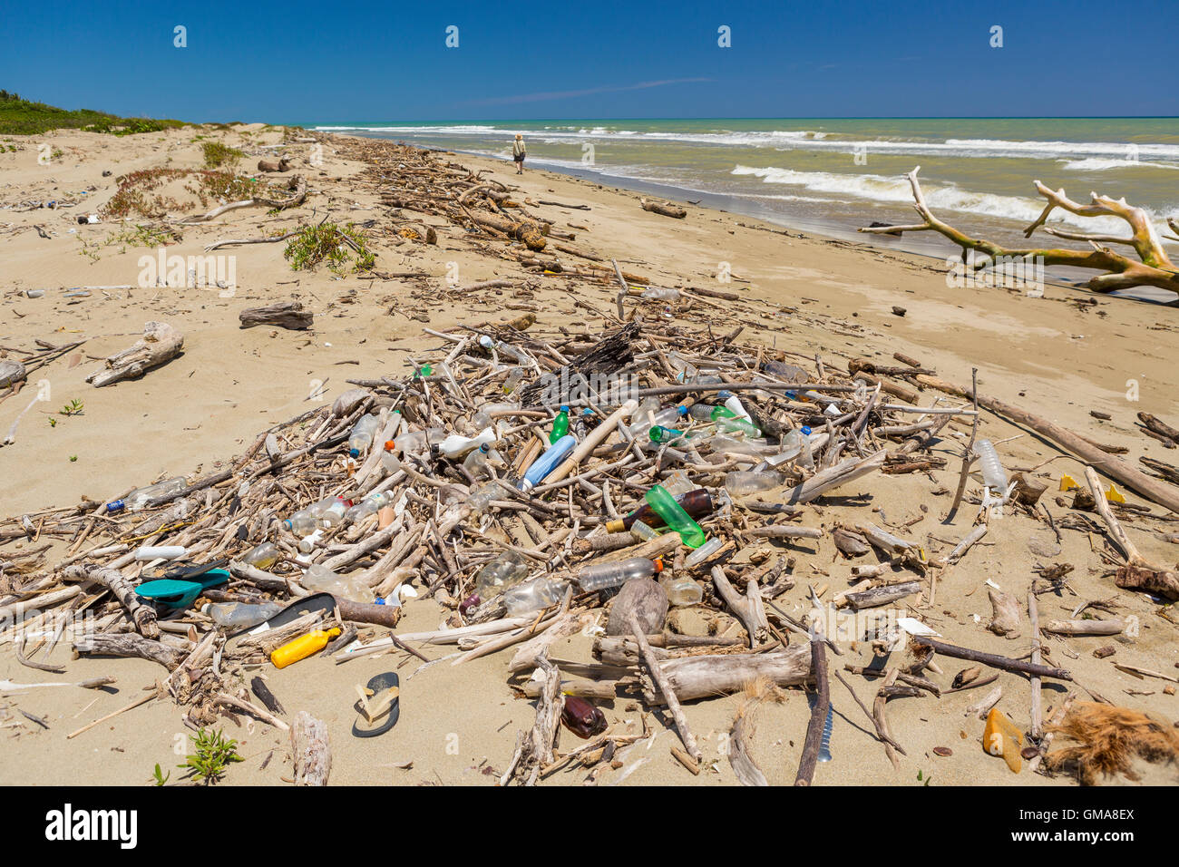 DOMINICAN REPUBLIC - Garbage on beach, plastic bottles and trash, near mouth of Yasica RIver. - Stock Image