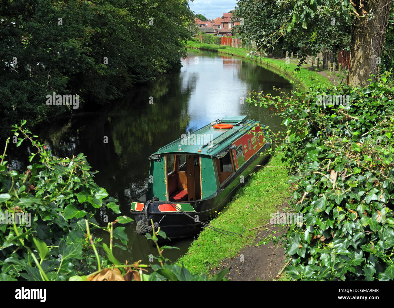 Narrowboat barge, boat moored on the Bridgewater Canal, Grappenhall village, Warrington, Cheshire, WA4 2PL, in summer - Stock Image