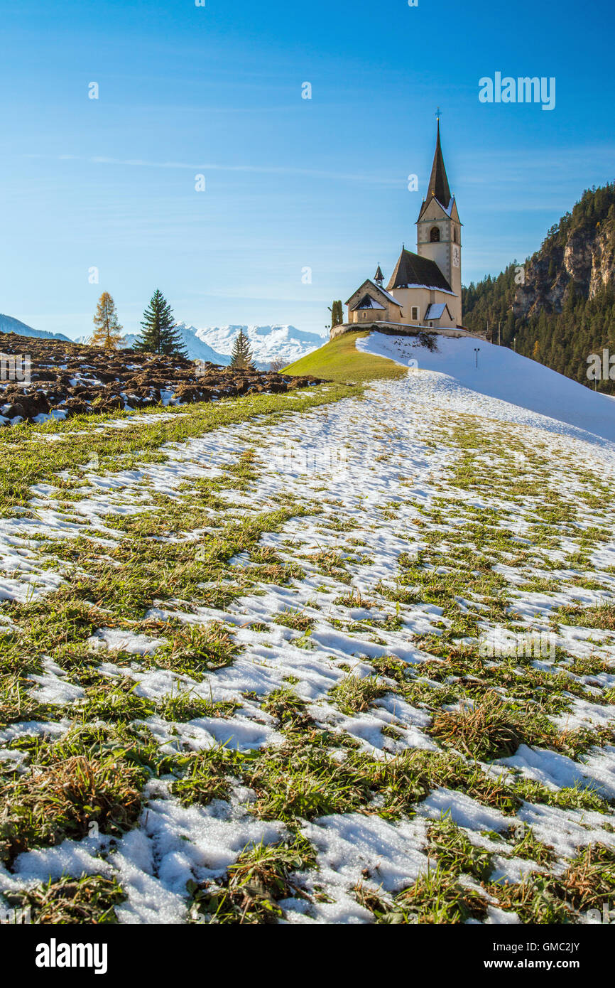 The church of the little village of Schmitten surrounded by snow Albula District Canton of Graubünden Switzerland Stock Photo