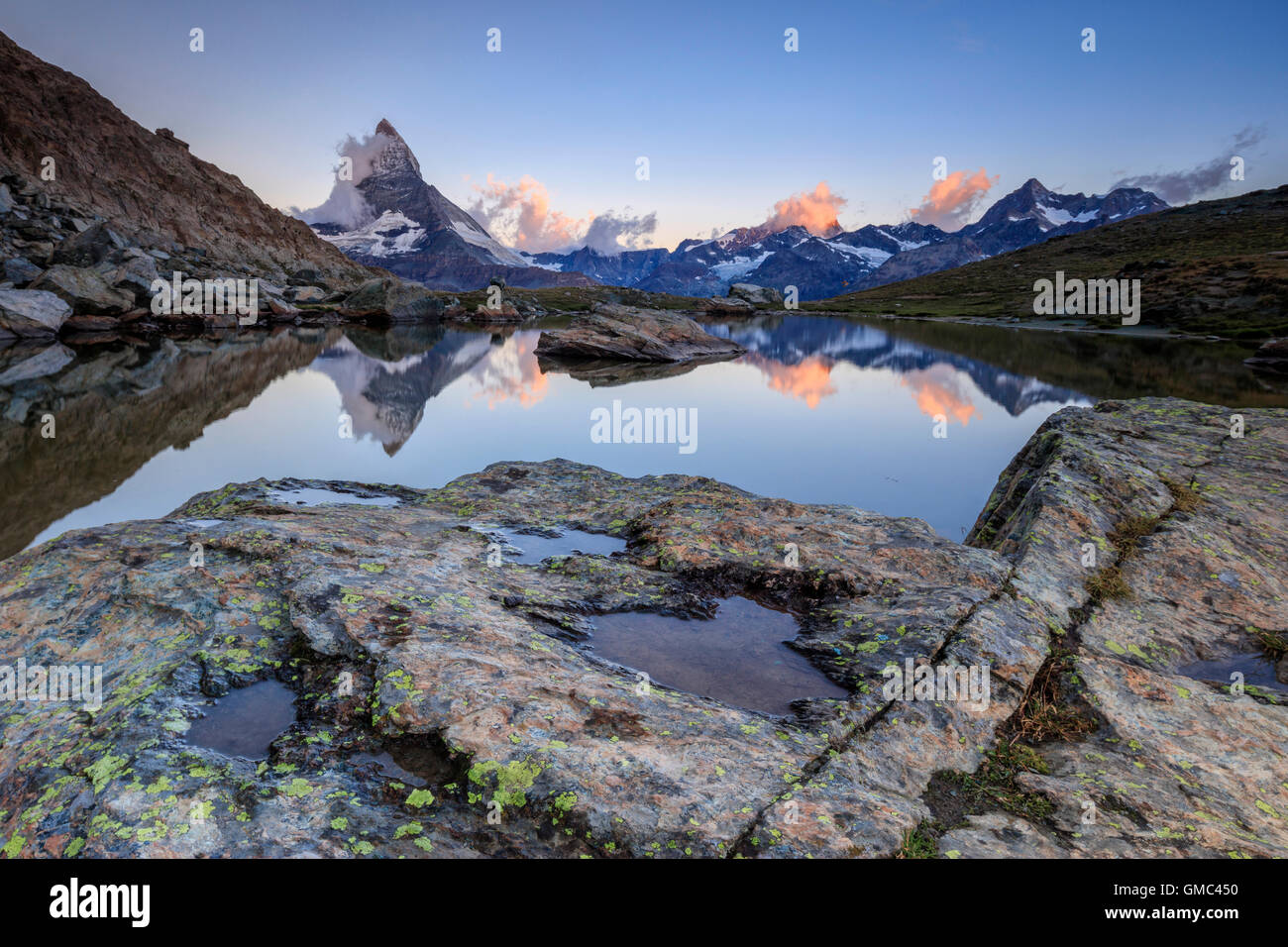 Matterhorn reflected in Lake Stellisee at dawn Zermatt Pennine Alps Canton of Valais Switzerland Europe - Stock Image