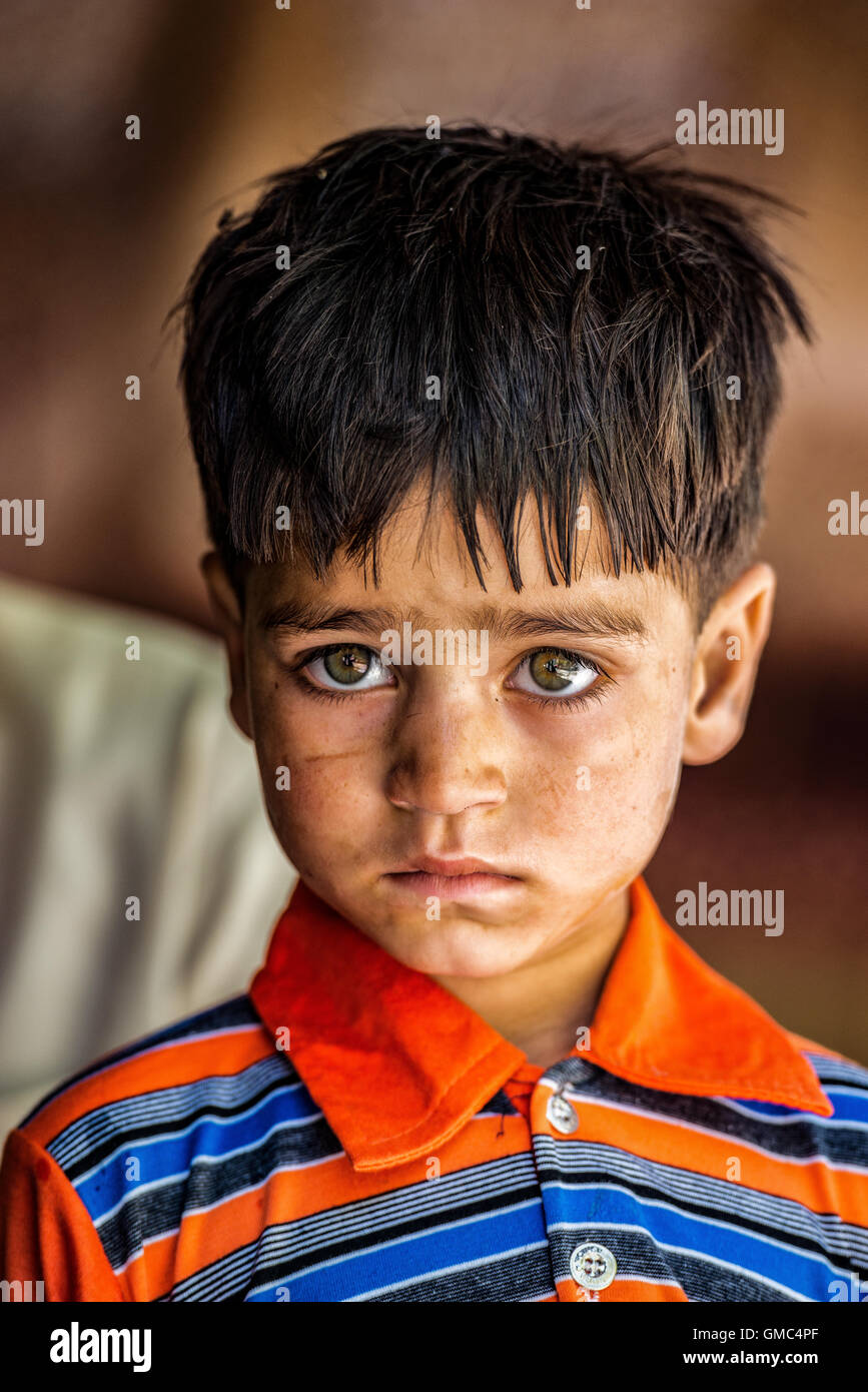 Small Pakistani boy in a tea house beside the Karakoram Highway between Gilgit and Islamabad - Stock Image