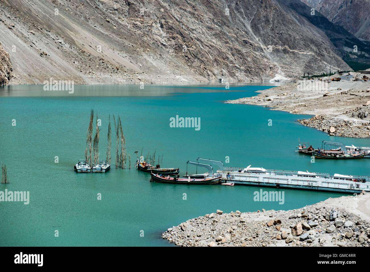 Abandoned ferry boats and pontoons on Attabad lake in the Gojal valley, Hunza, Gilgit-Baltistan, Pakistan - Stock Image