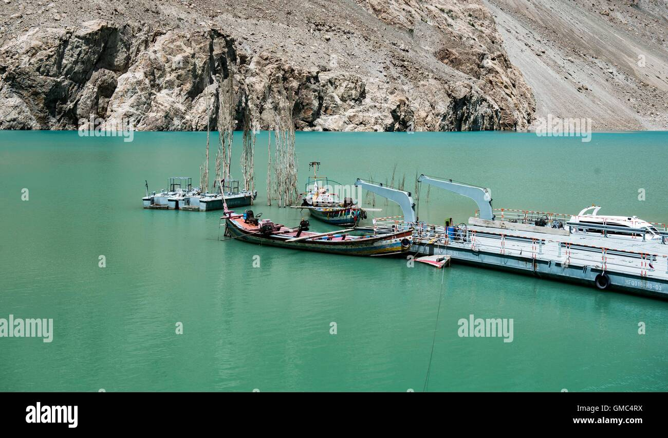 Abandoned ferry boats and pontoons on Attabad lake in the Gojal valley, Hunza, Gilgit-Baltistan, Pakistan Stock Photo