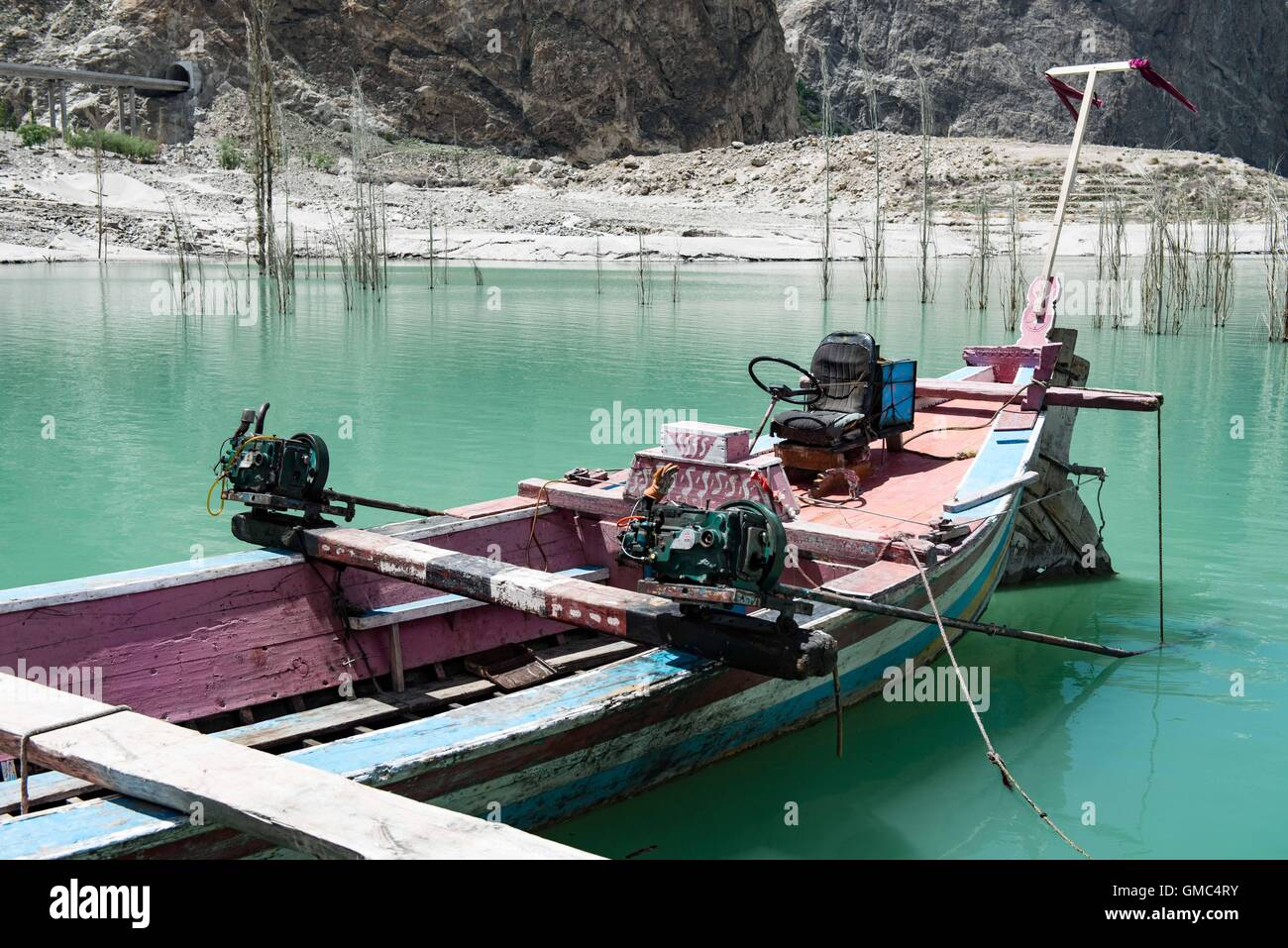 Abandoned ferry boat on Attabad lake in the Gojal valley, Hunza, Gilgit-Baltistan, Pakistan - Stock Image