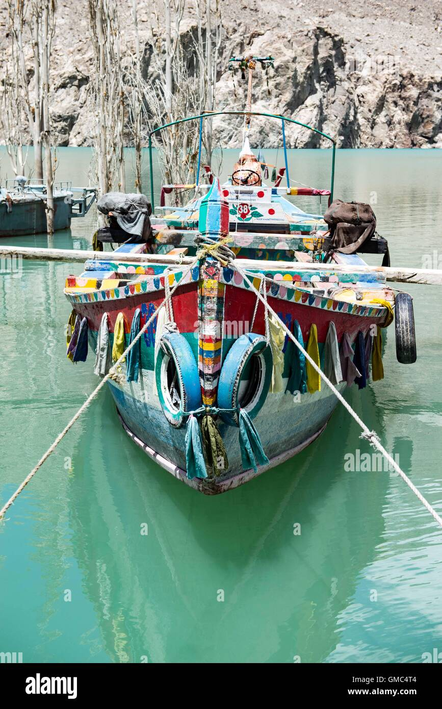 Redundant painted ferry boats and a pontoon on Attabad lake. - Stock Image