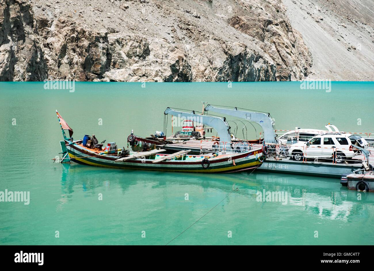Abandoned boats and pontoon in Attabad Lake, Gojal, also known as Gojal Lake - Stock Image