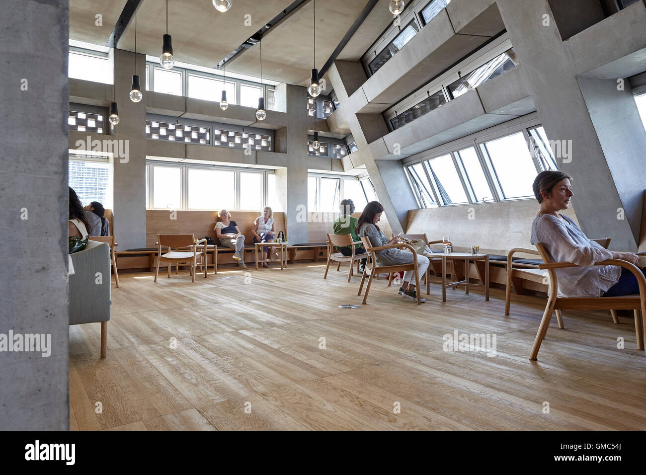 People relaxing in the cafe canteen area switch house at tate modern london united kingdom architect herzog de meuron 2016