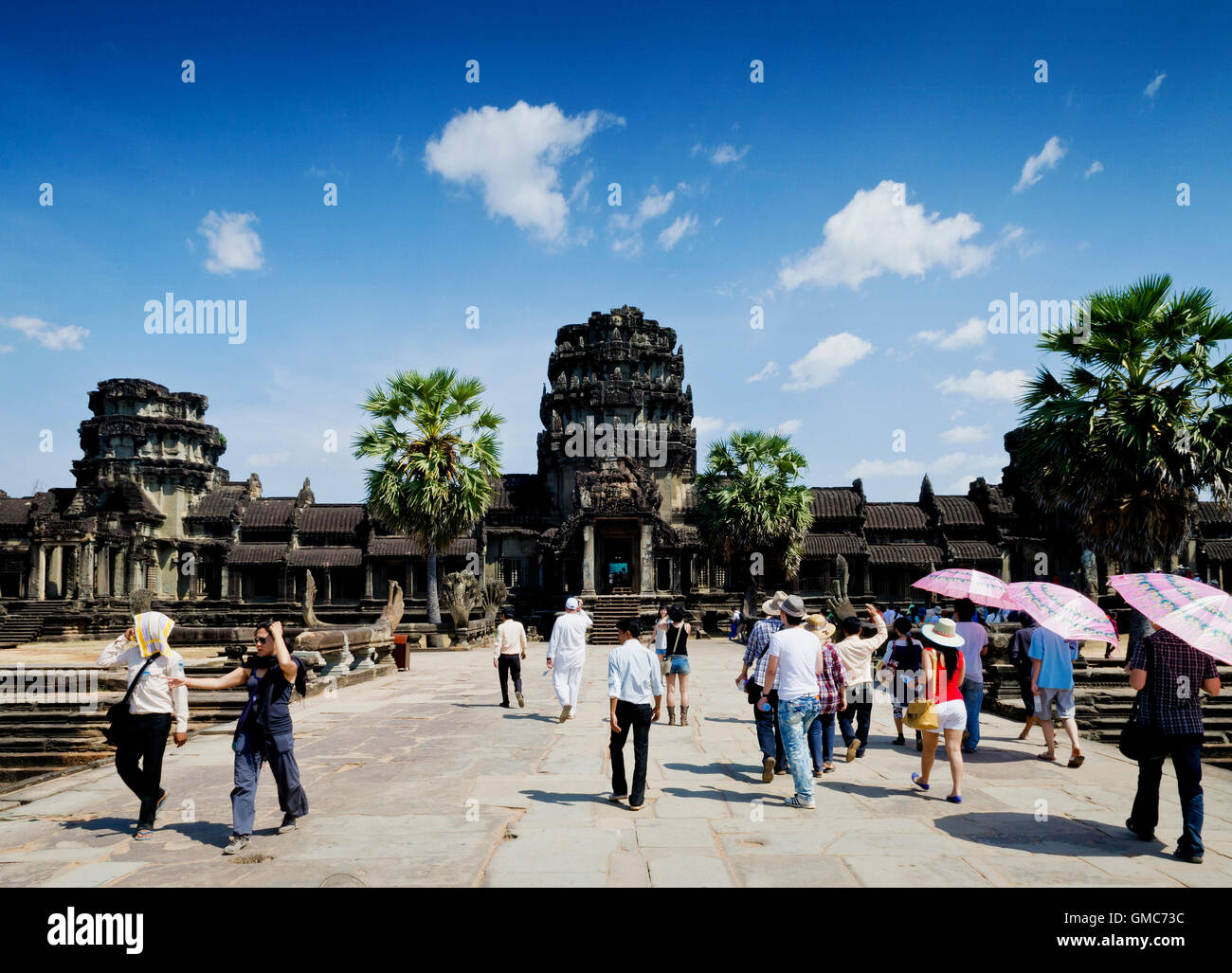 tourists main entrance of angkor wat temples famous asian landmark in siem reap cambodia - Stock Image