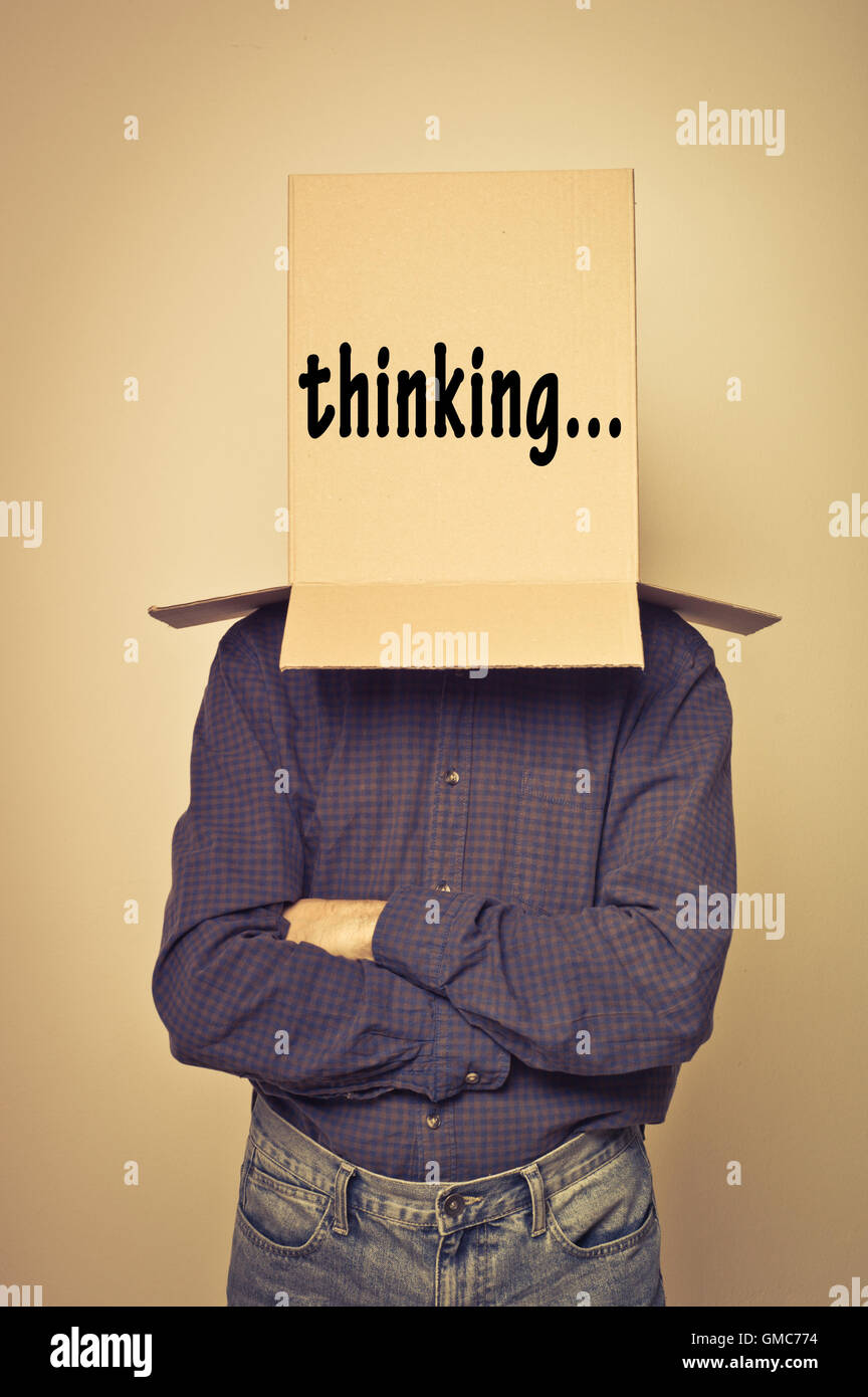 man with a box over the head, I am thinking concept - Stock Image