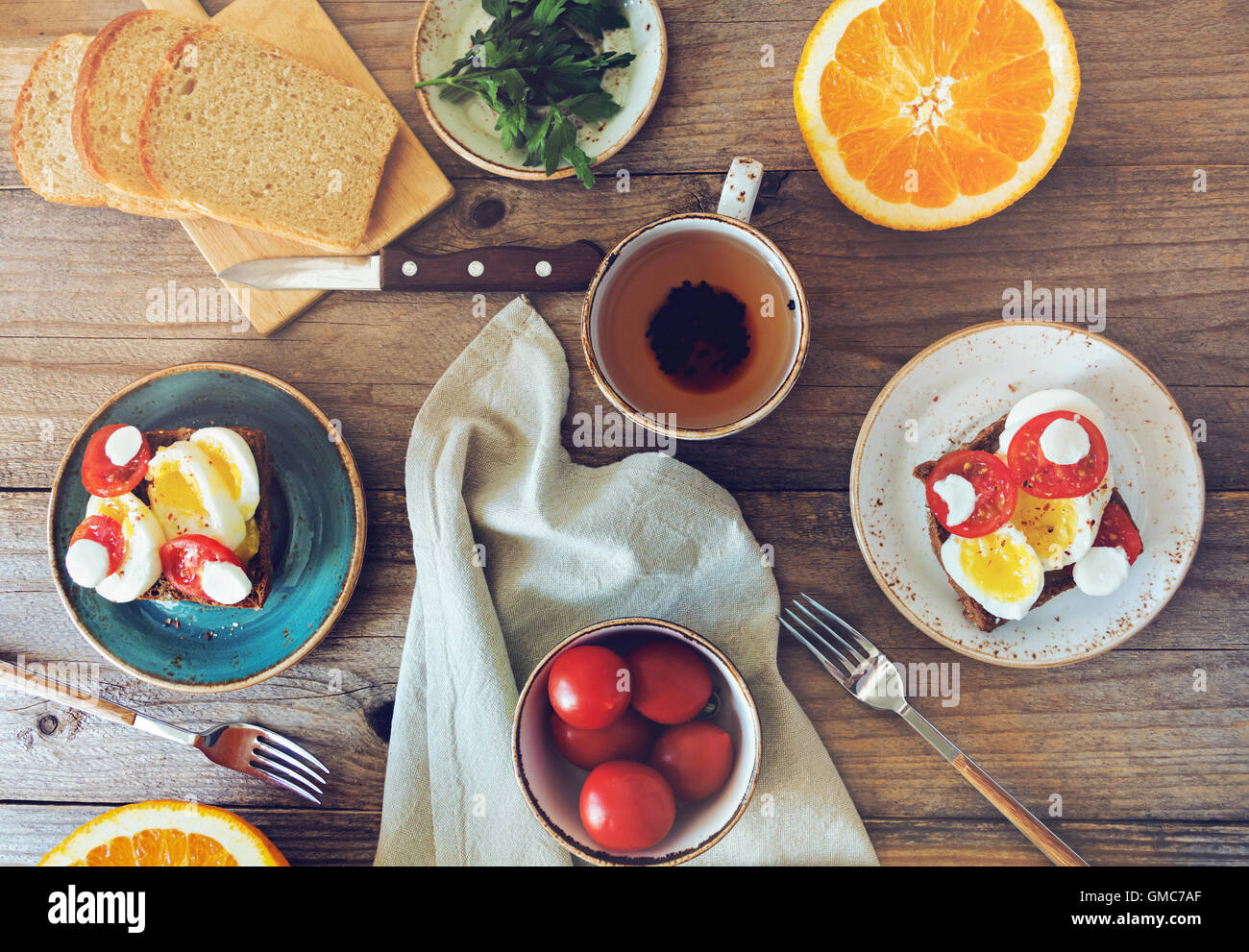 Top view of healthy breakfast table set for two. Sunday summer morning. Toned image & Top view of healthy breakfast table set for two. Sunday summer Stock ...