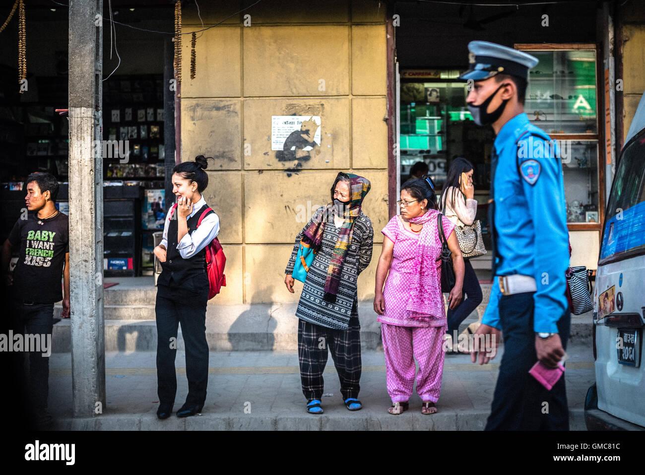 Kathmandu citizens are waiting for bus after office hours. Kathmandu, Nepal. © Reynold Sumayku - Stock Image