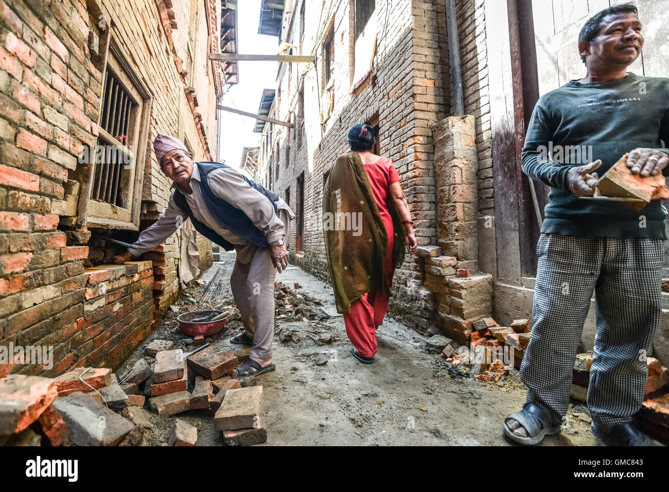 Men doing construction work in Bhaktapur, Nepal. © Reynold Sumayku Stock Photo