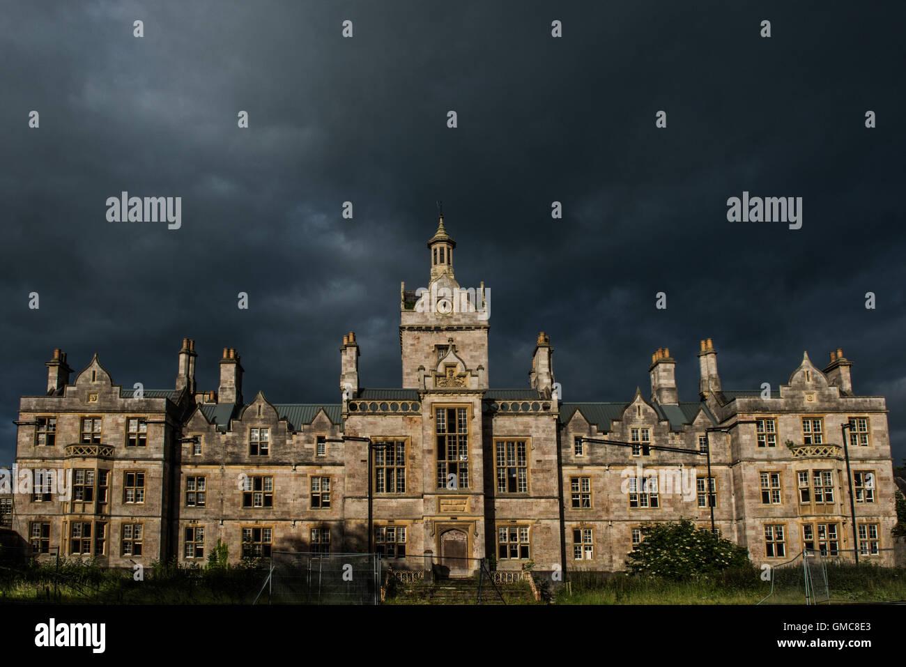 Stormy sky over the imposing Denbigh Asylum, Denbigh, Denbighshire, Wales, UK - Stock Image