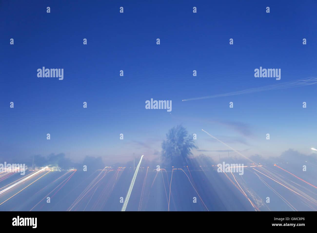 Dance the night light blurred background pattern. - Stock Image