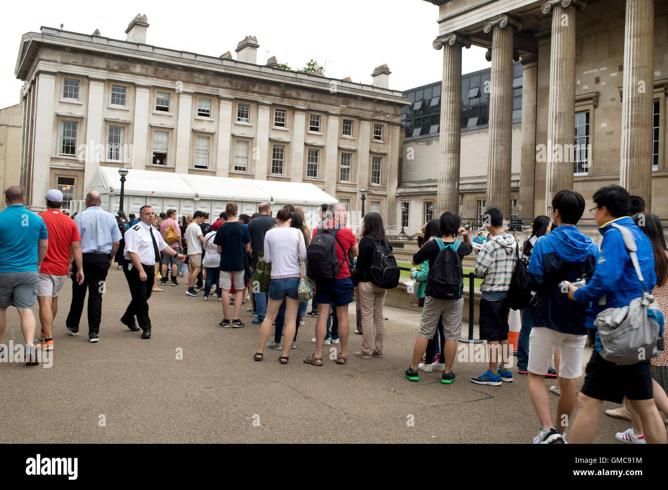 British Museum - visitors queue for security bag search. - Stock Image