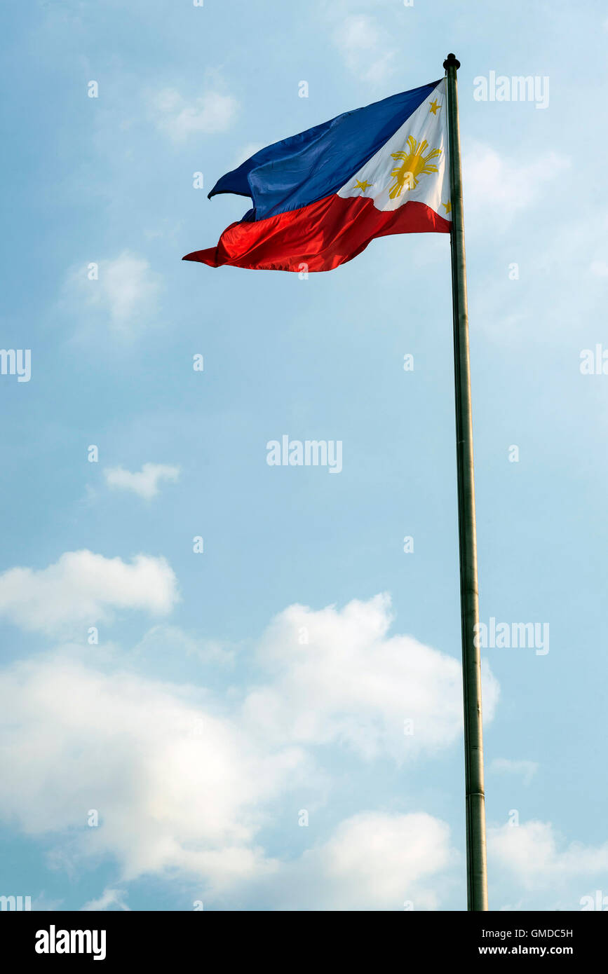 philippines filipino flag flying on flagpole in manila Stock Photo