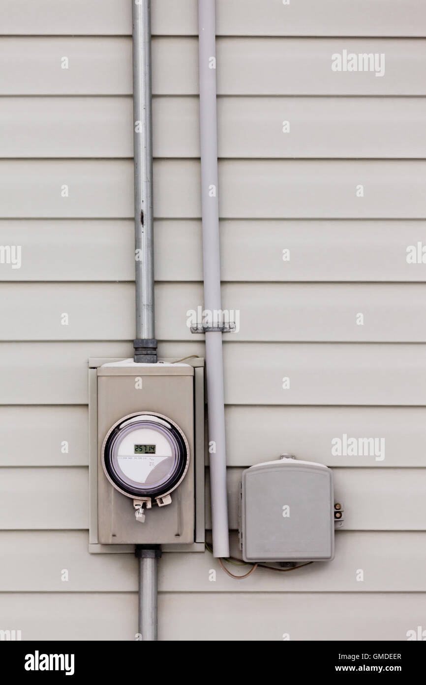 Smart grid power supply meter and phone line drop - Stock Image