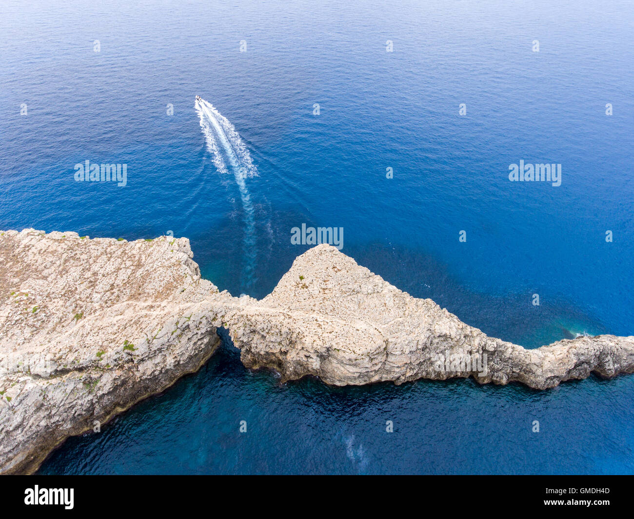 Aerial view at Pont d'en Gil with speeding boat - Stock Image