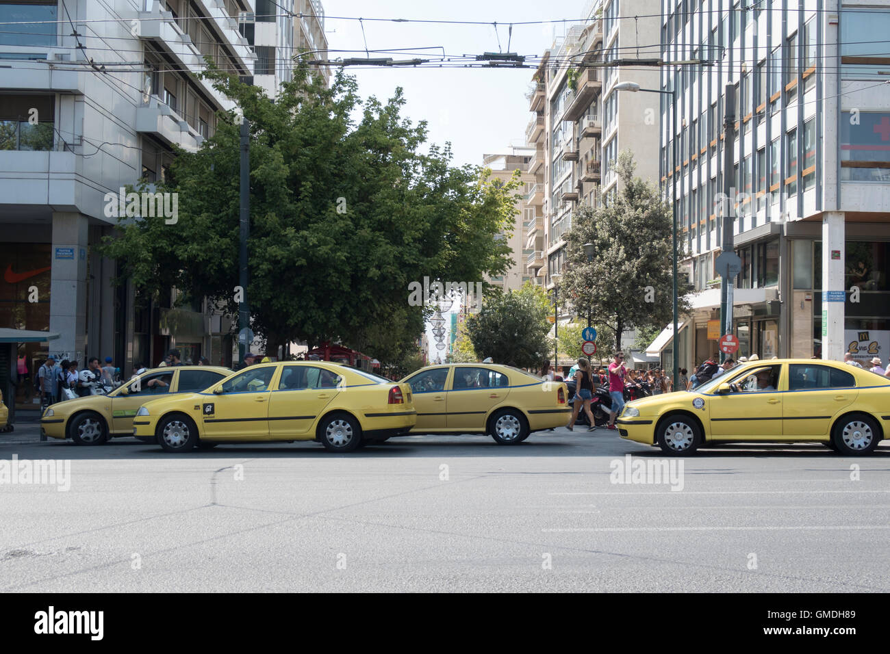 Athens, Greece - August 06 2016: Yellow taxis on Syntagma square. - Stock Image