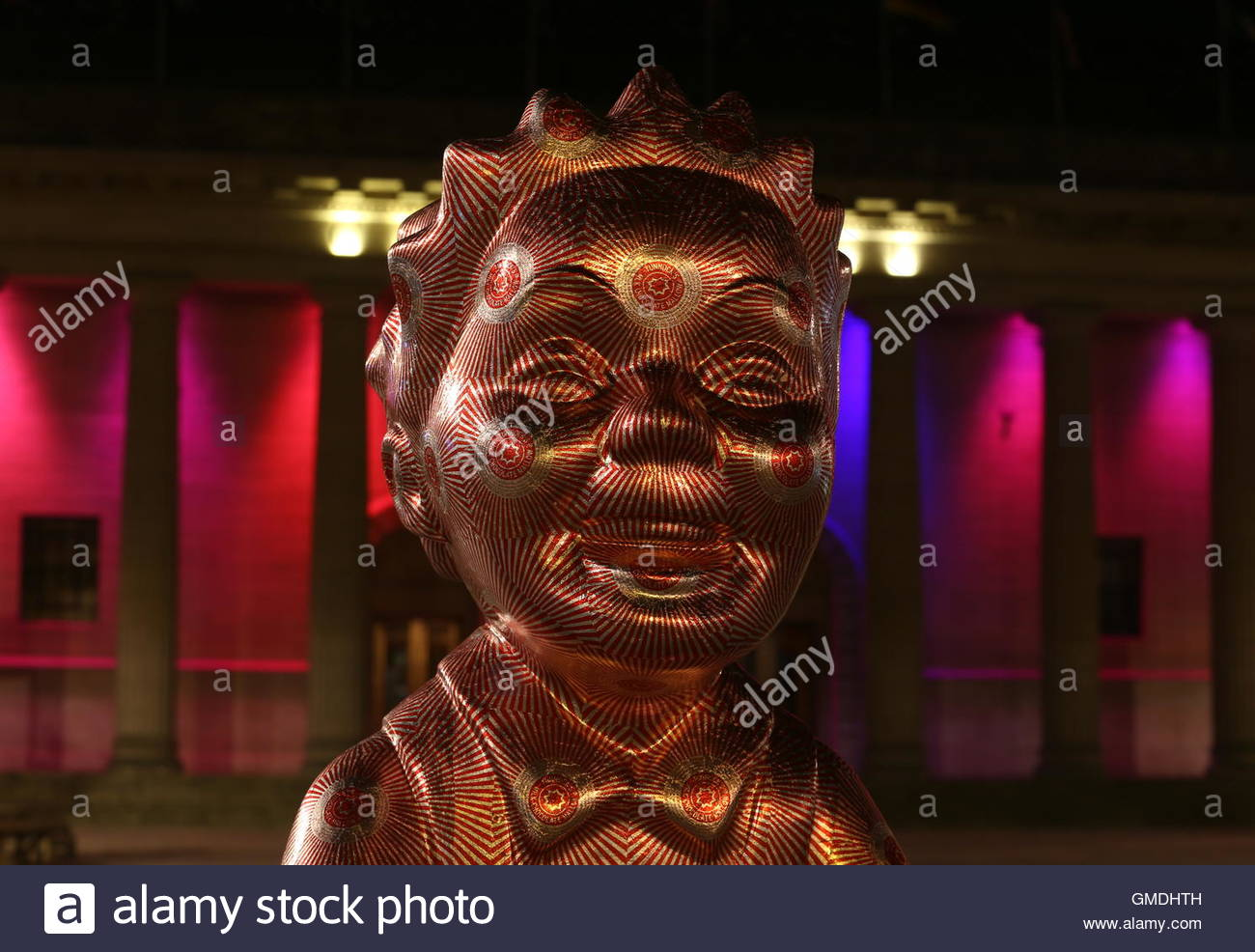Guilded Wullie by Robert Mach one of the touring Oor Wullie statues back in City Square by night Dundee Scotland - Stock Image