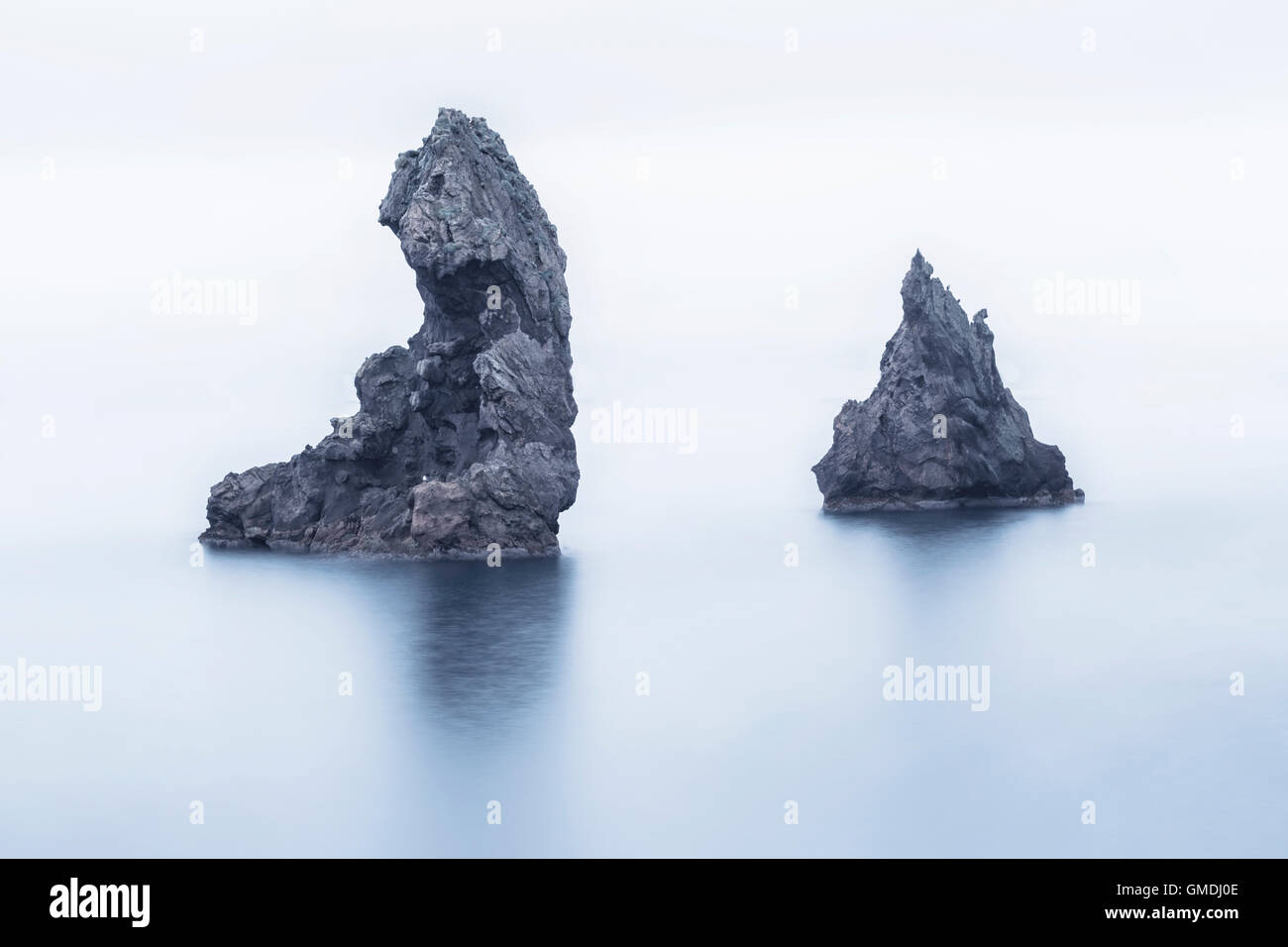 lava formation in the North Coast of Heimaey, Vestmannaeyjar, Iceland, Europe, troll, islands, sea stacks, long - Stock Image