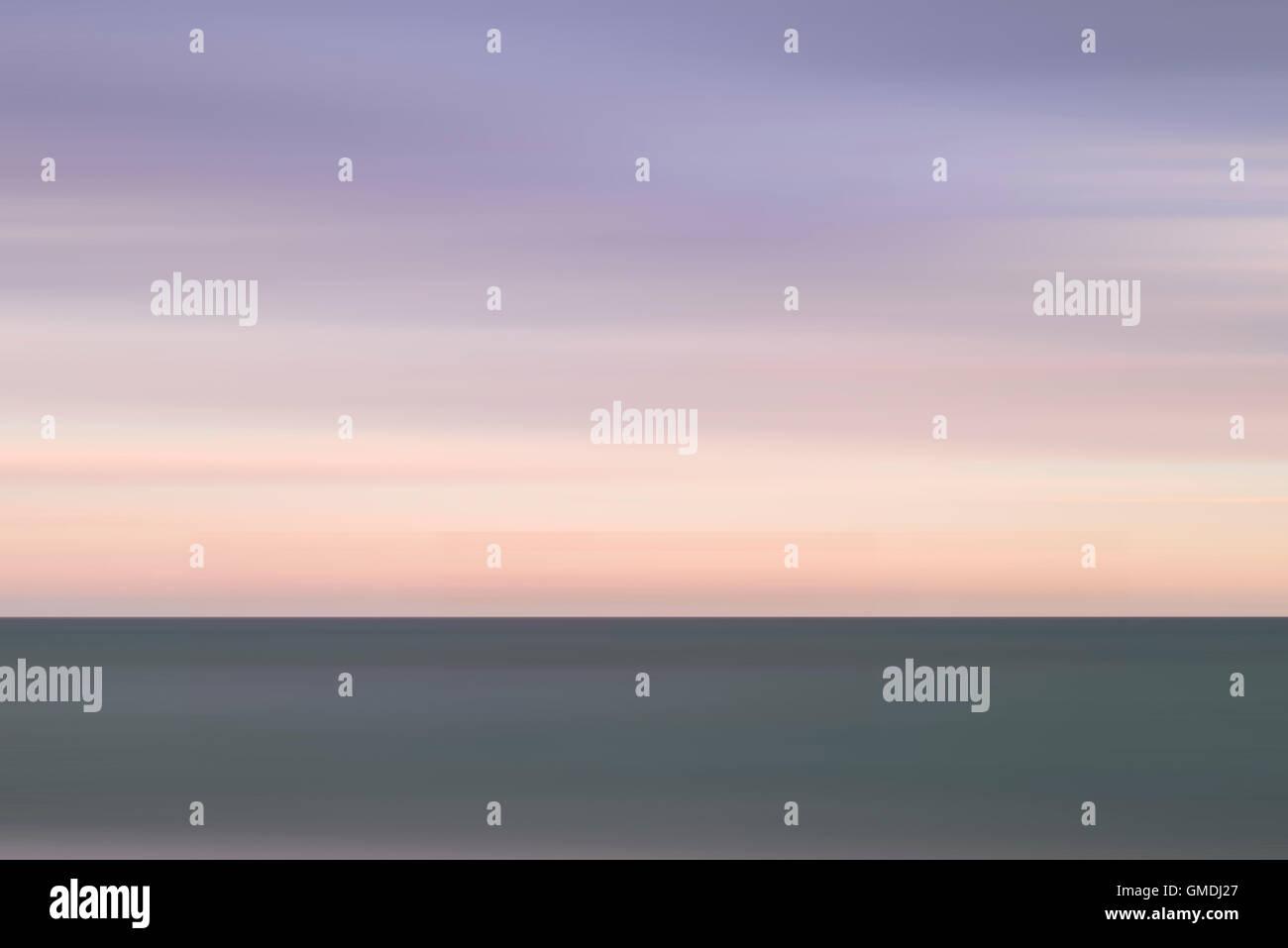 Beautiful vibrant conceptual image of peaceful sea at sunset - Stock Image