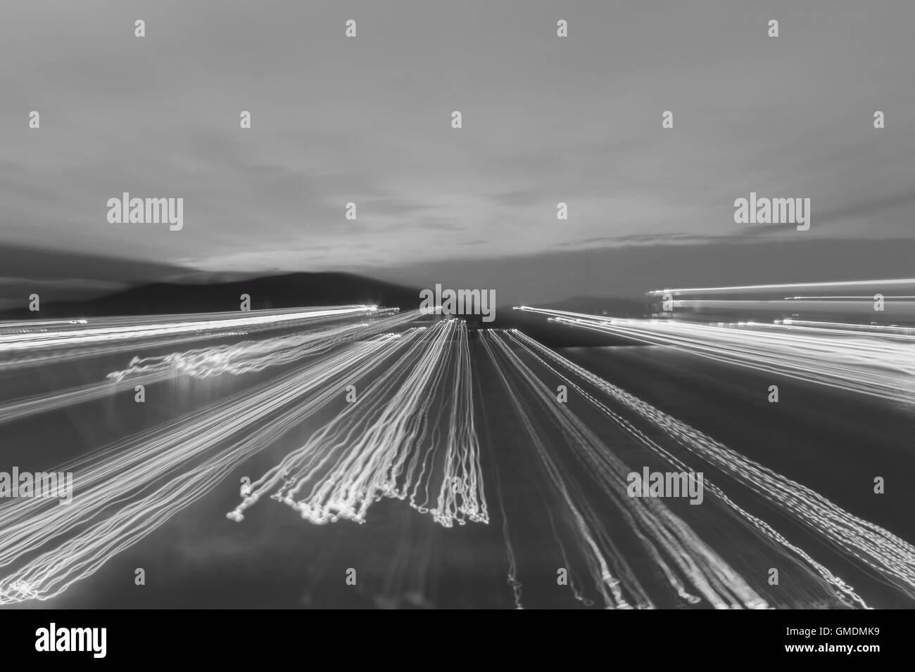 Black & white light at night. Background pattern - Stock Image