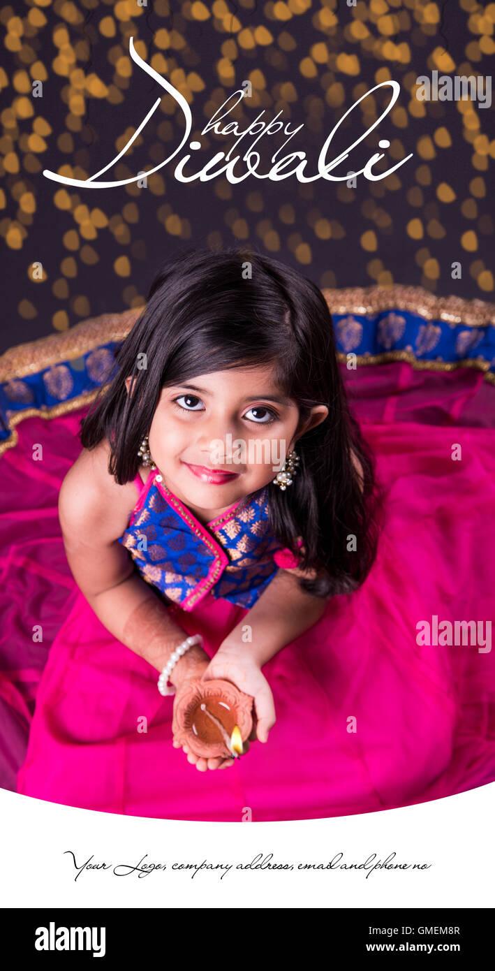 Ihappy diwali greeting card ndian girl holding diya on diwali or ihappy diwali greeting card ndian girl holding diya on diwali or posing in traditional wear m4hsunfo