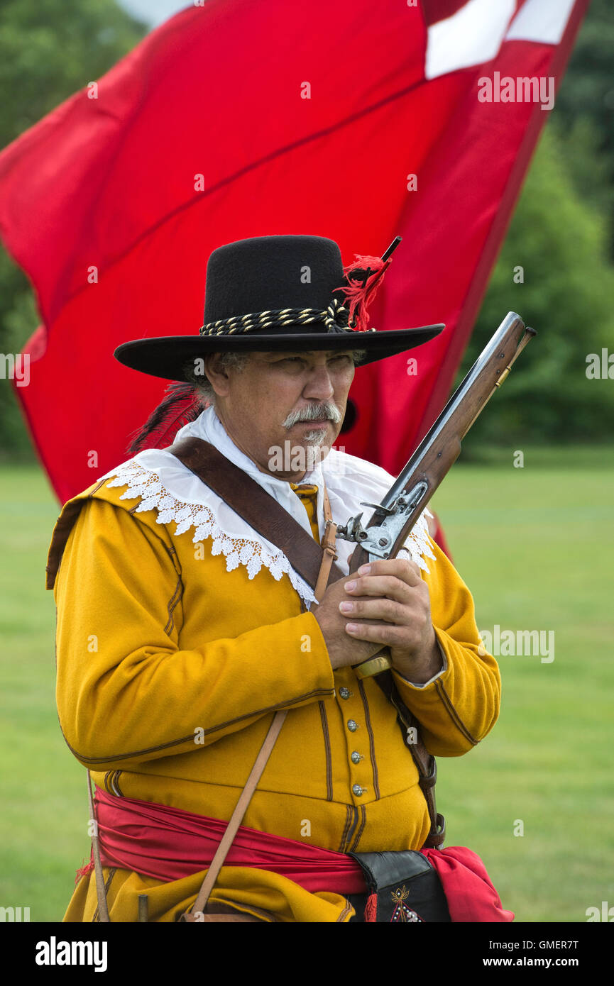 English Civil War Royalist Soldier priming his flintlock military pistol at a reenactment, Spetchley Park, Worcestershire, Stock Photo