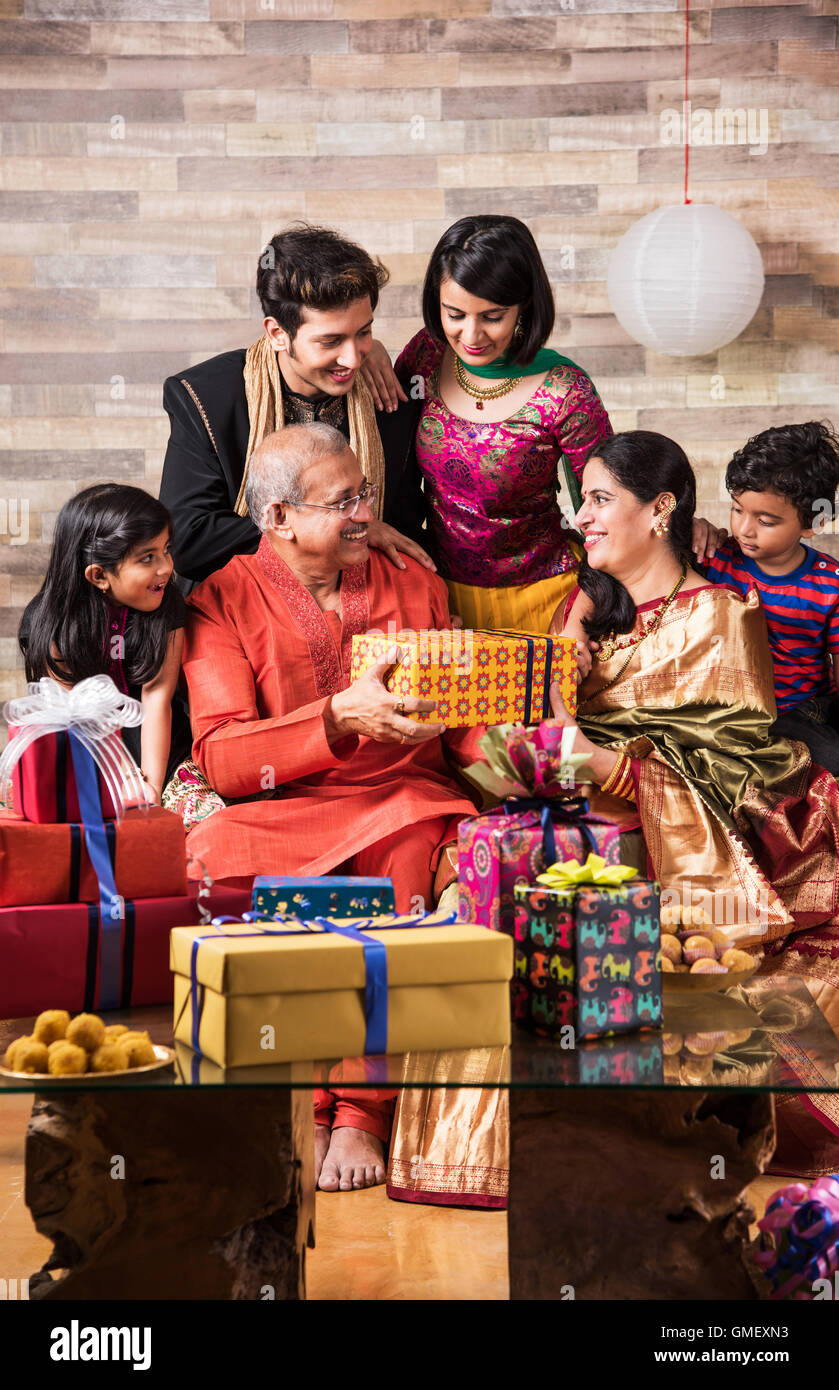 Indian family celebrating diwali festival or birthday by exchanging ... for Diwali Gifts For Family  29dqh