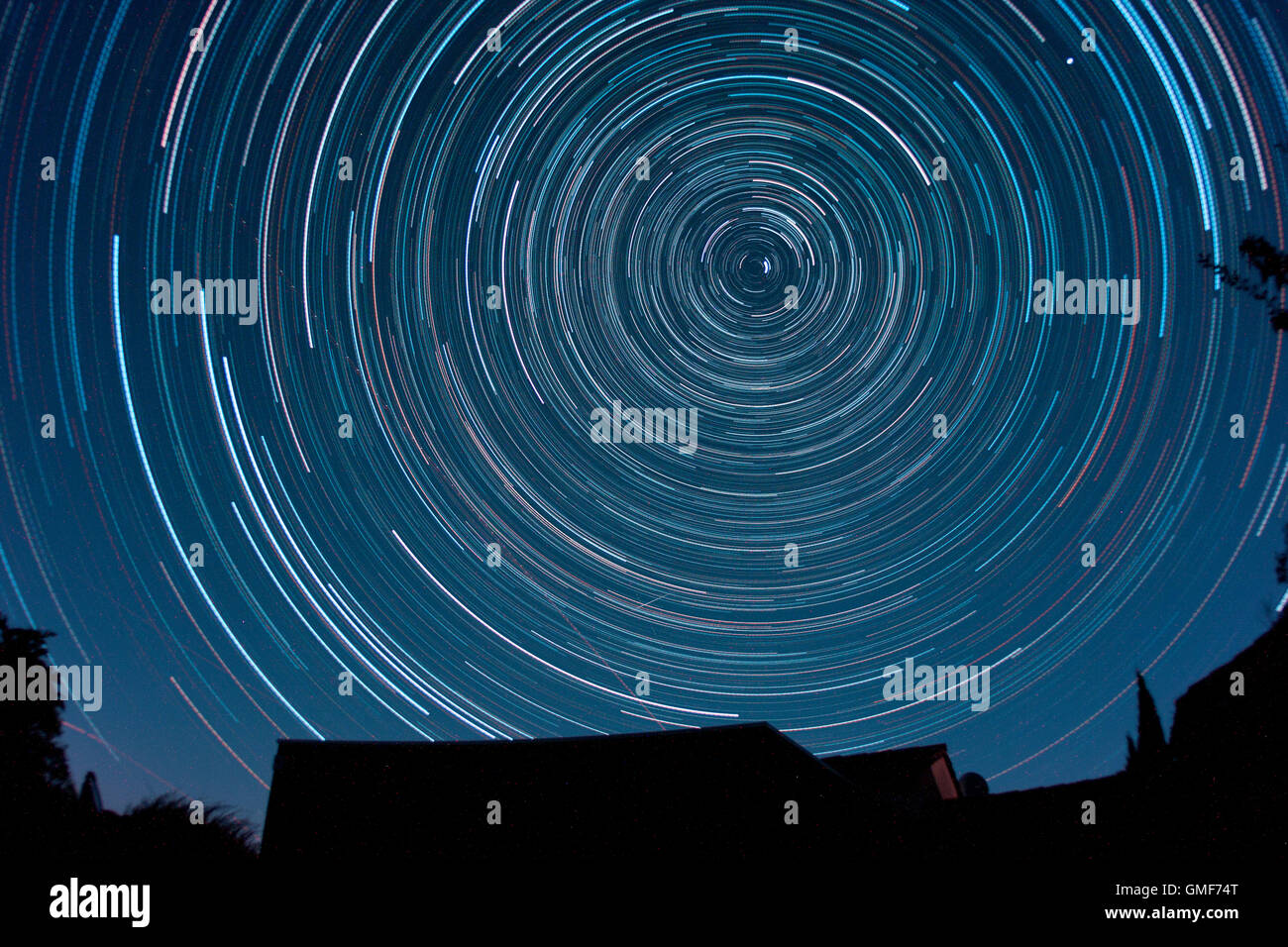 Sablet, Provence Alpes, France. 25th August 2016. 3.5 hour star trail exposure above a Provence village house. Single - Stock Image