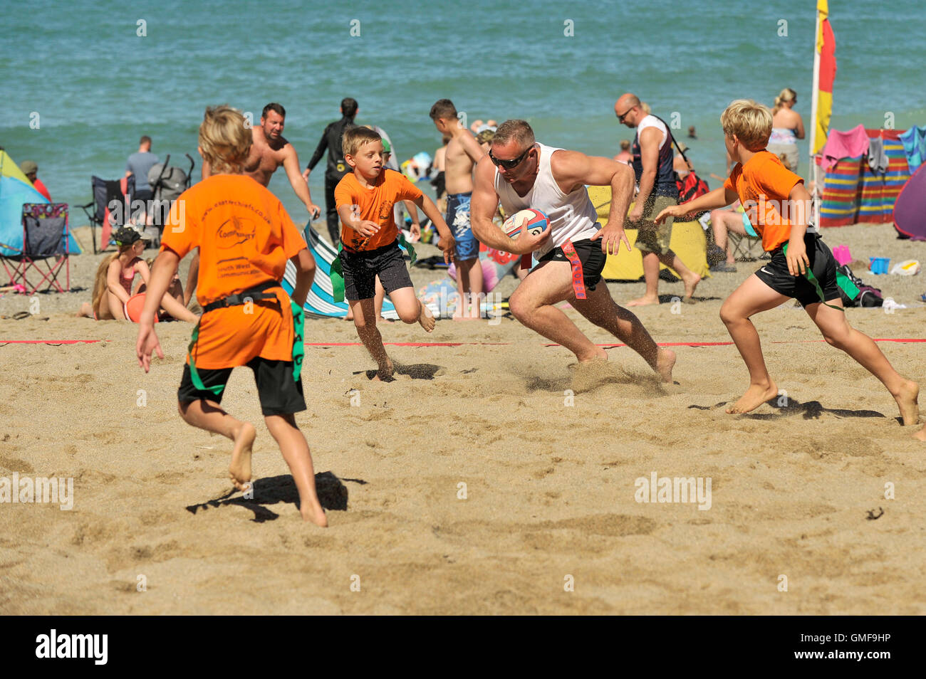 Newquay, UK. 26th Aug, 2016. Lusty Glaze, Newquay, Cornwall. 26th August, 2016. Three young players from a St Agnes - Stock Image